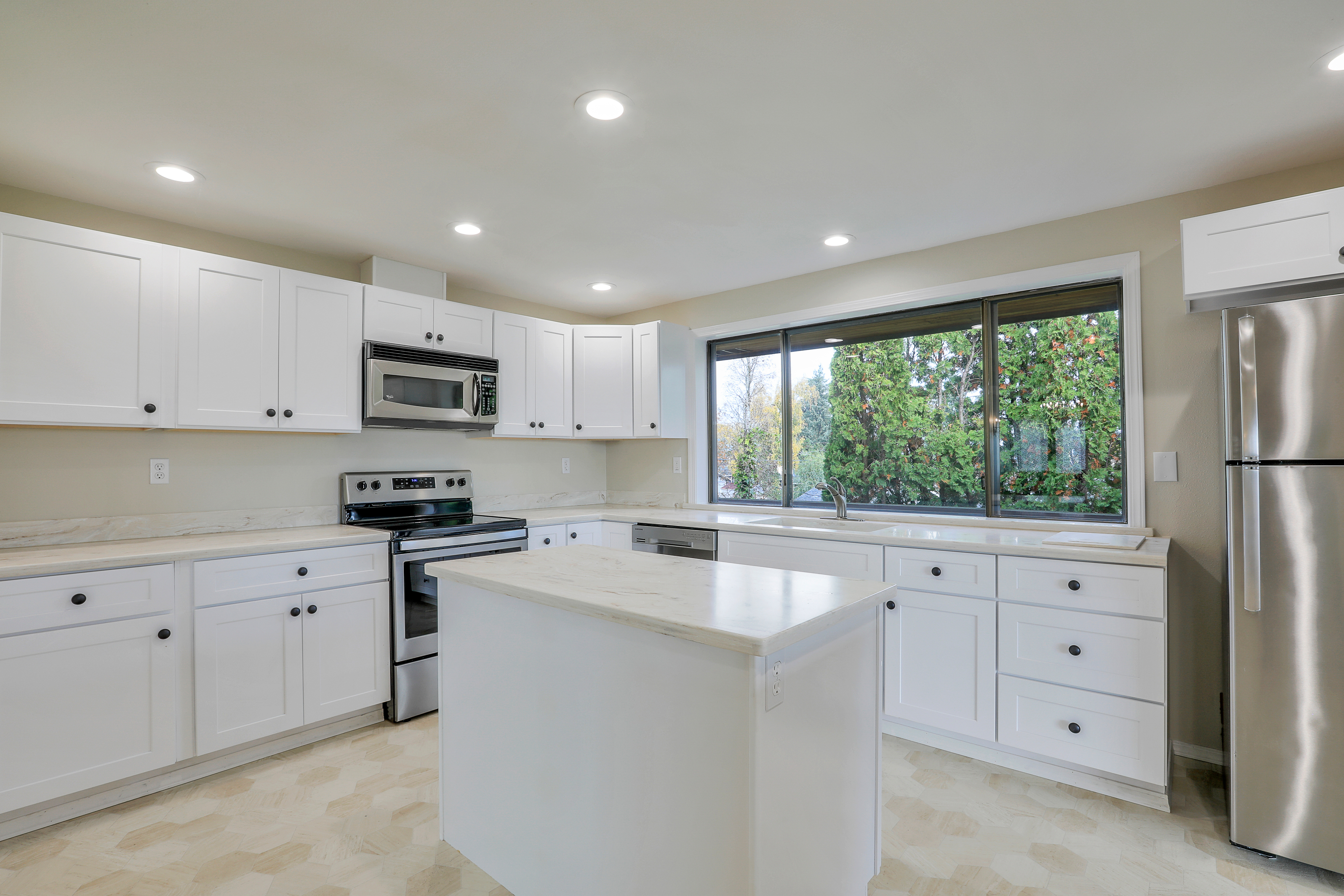 Recently updated kitchen featuring <br>Corian counters and stainless appliances