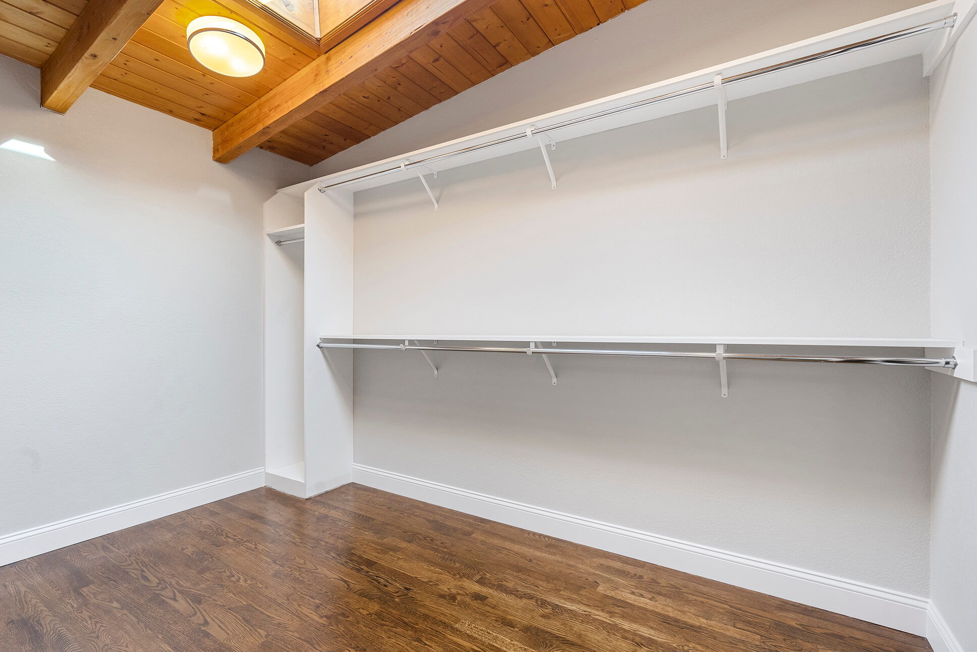 Large walk-in closet with ample room for storage