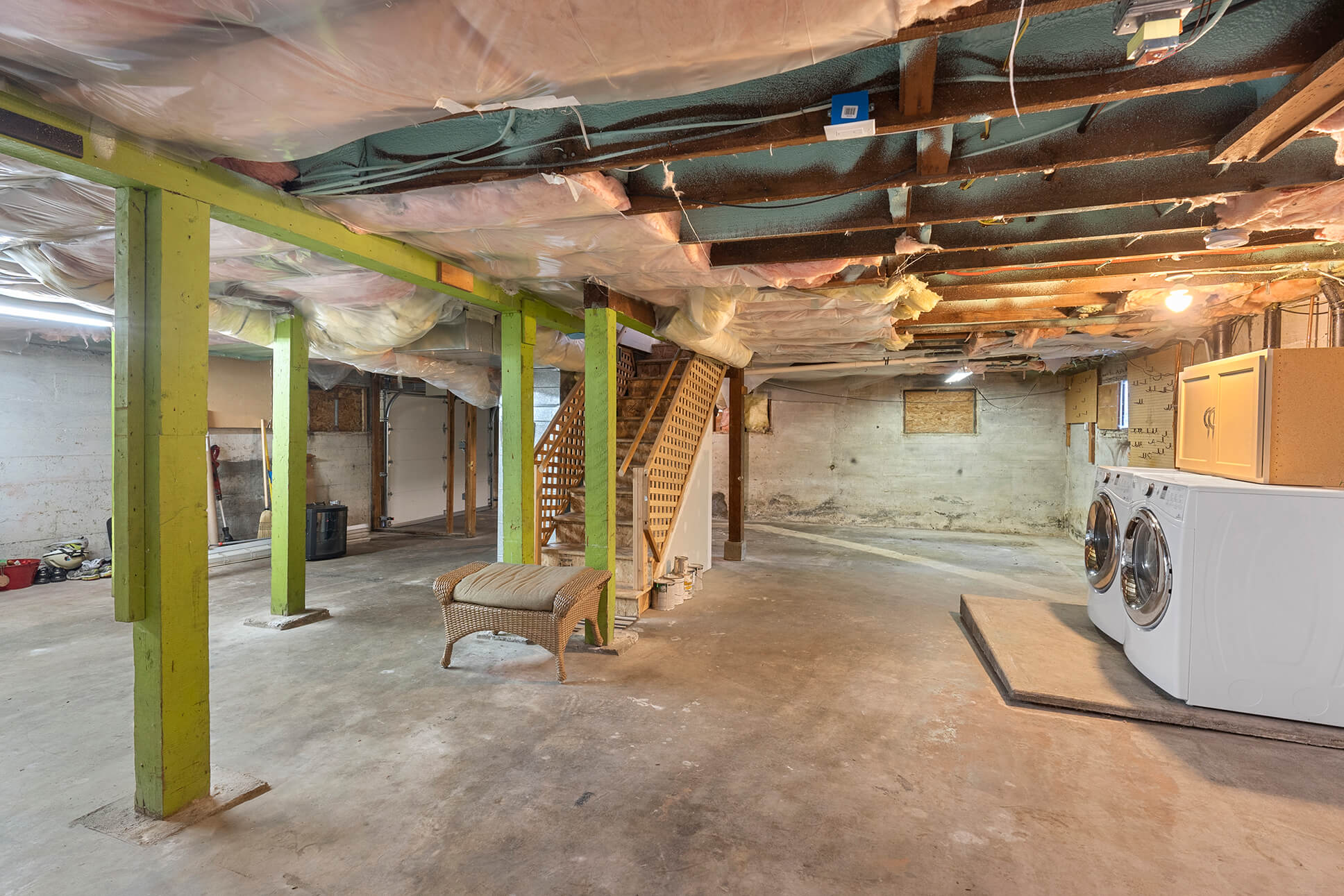 Unfinished basement with laundry and oversized one car garage