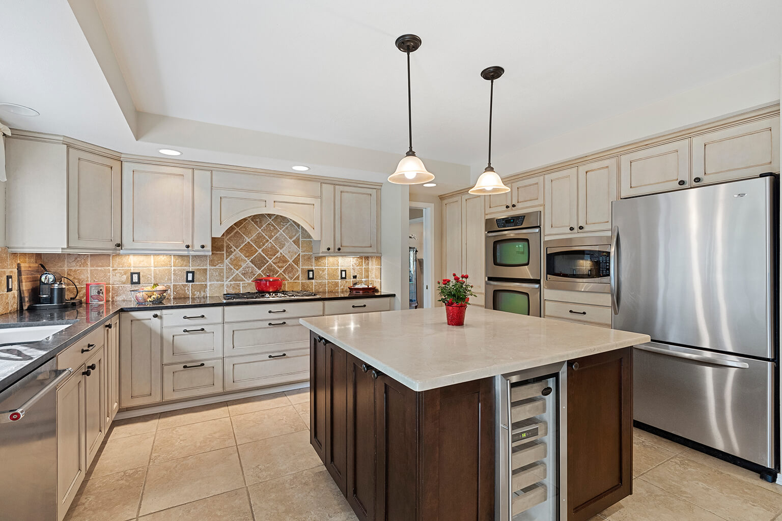 Updated gourmet kitchen with stainless appliances