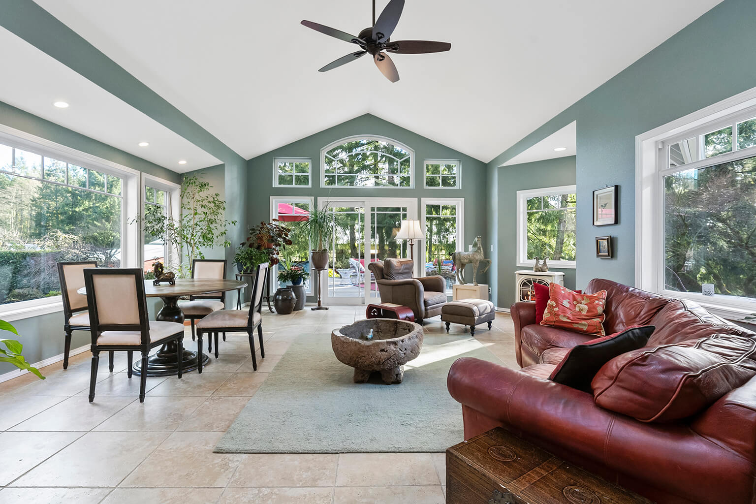 Great room with vaulted ceiling and heated tile floors