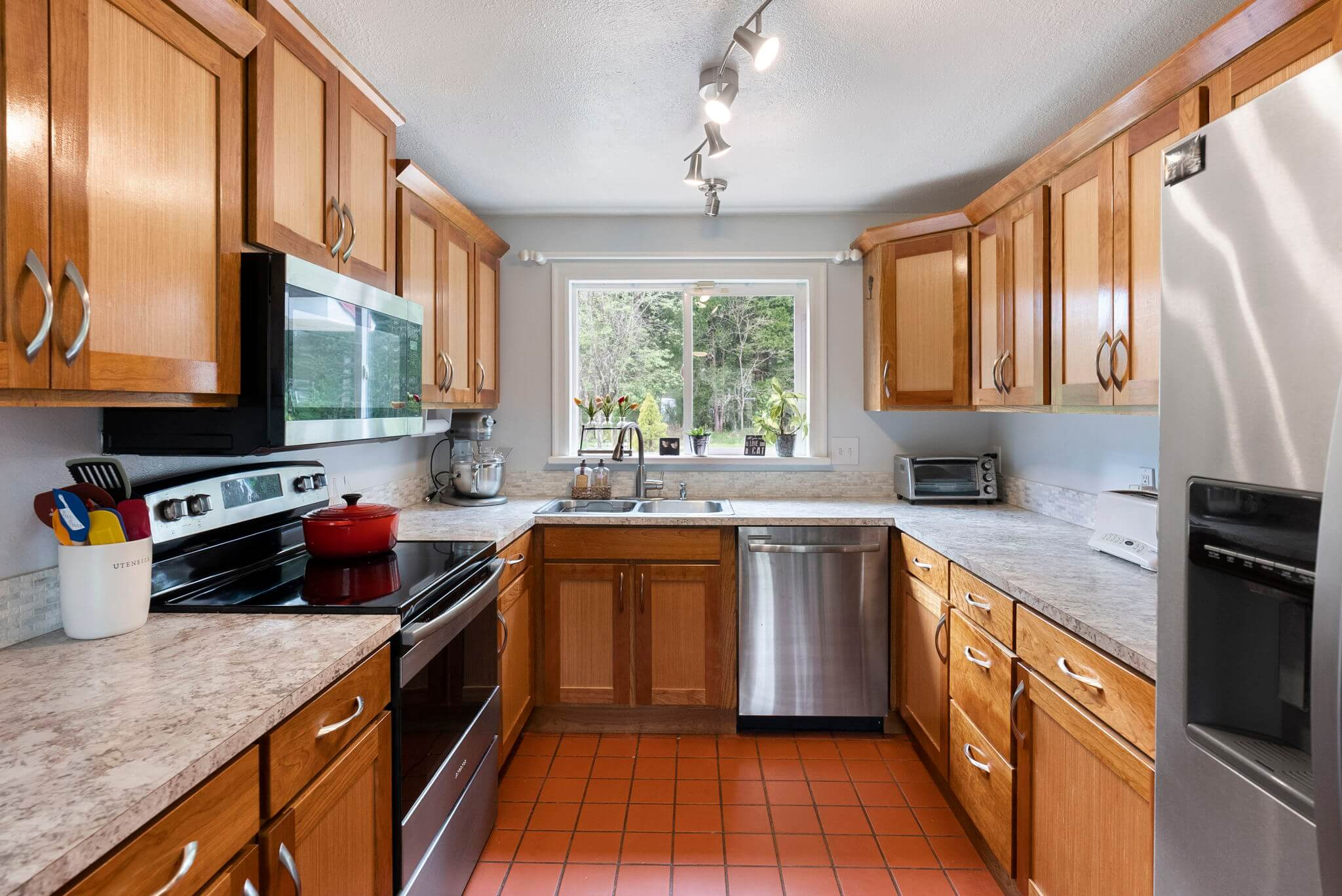Updated kitchen with cherry cabinets and stainless appliances