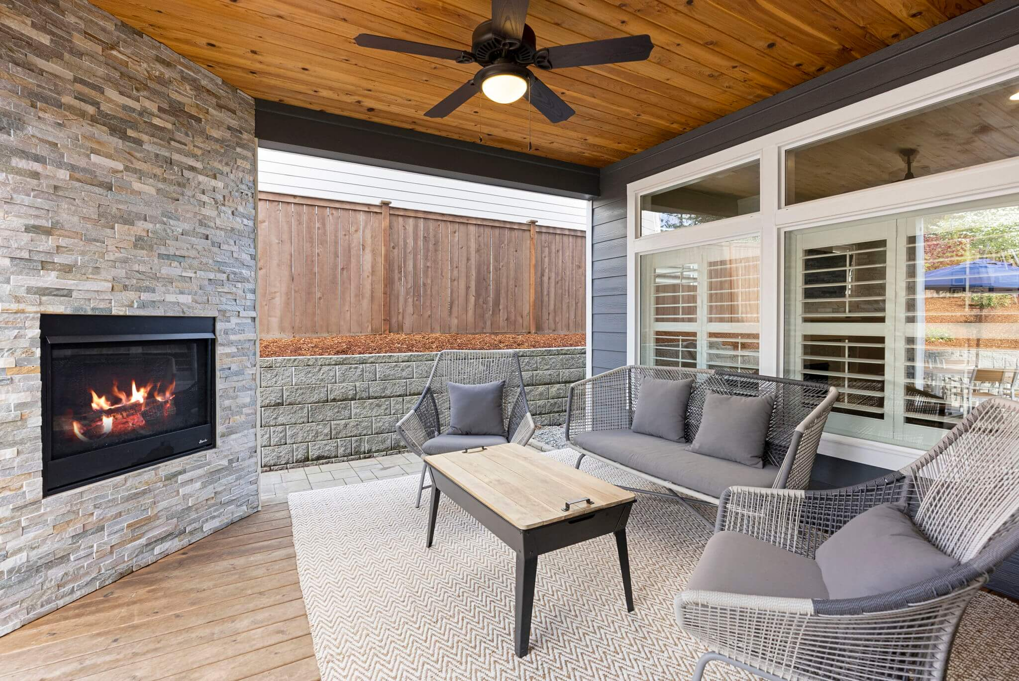Covered deck with its own gas fireplace