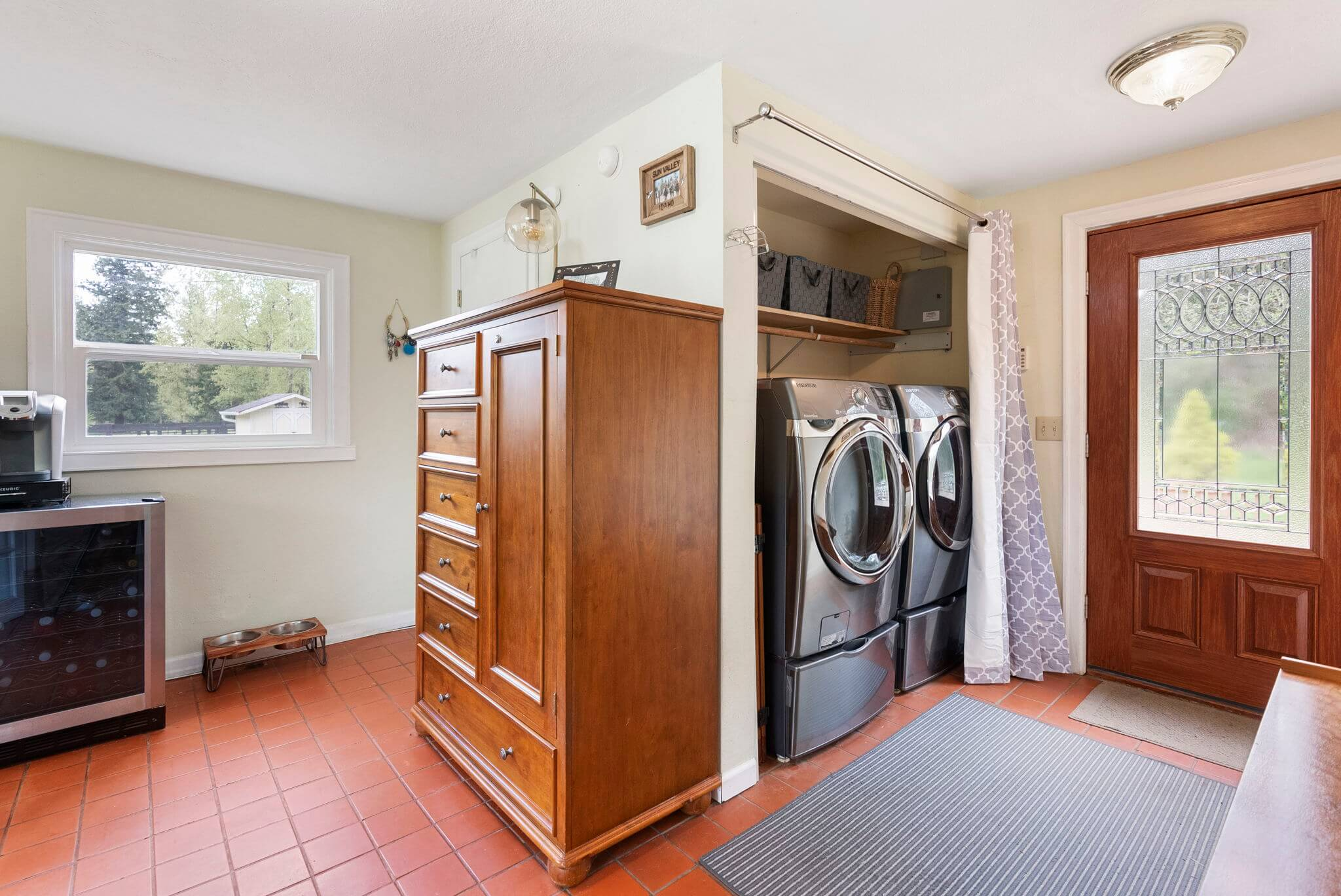 Home office includes a laundry area and door to back deck