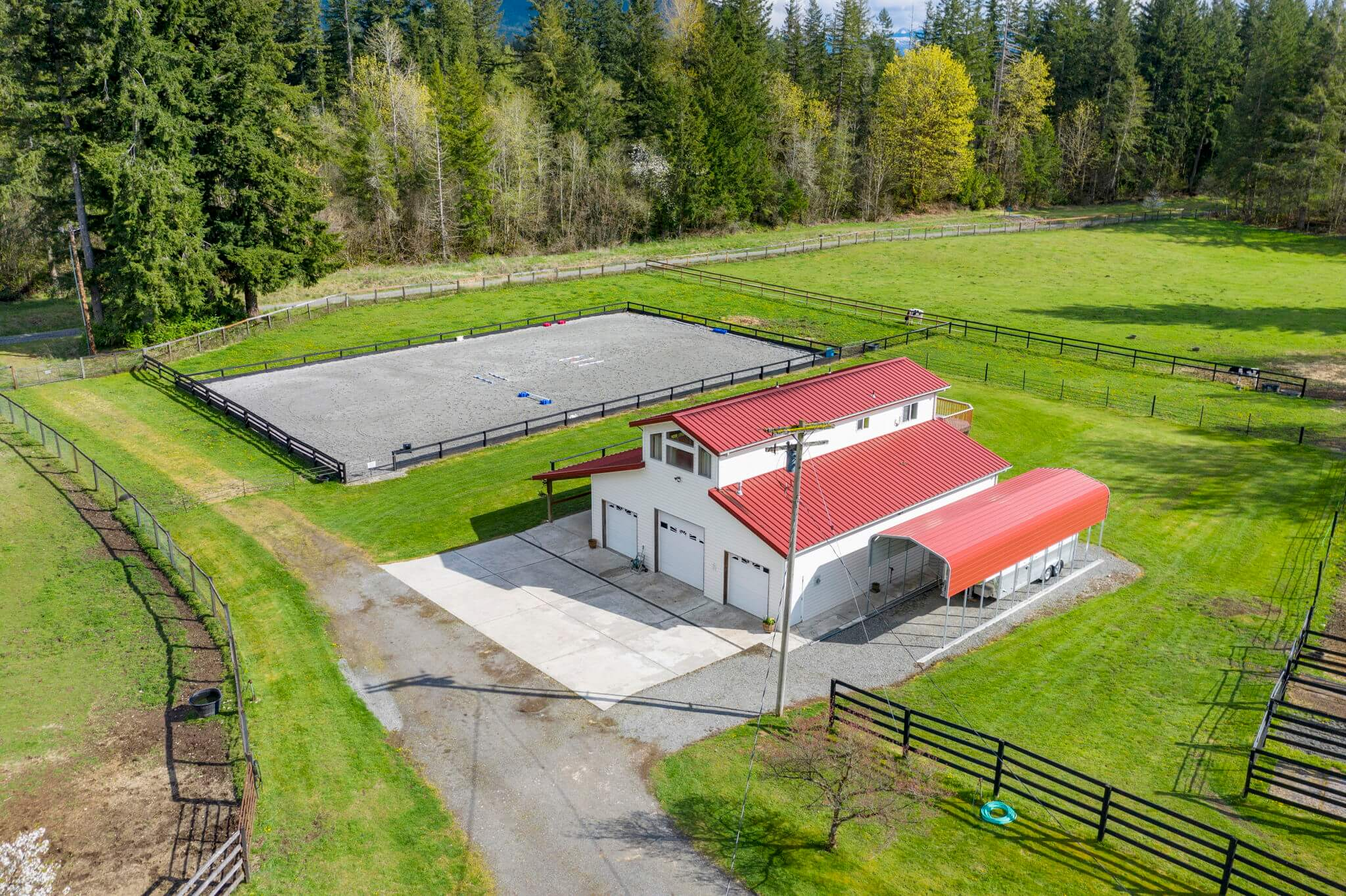 Outdoor arena and 48' x 50' barn with covered RV parking pad