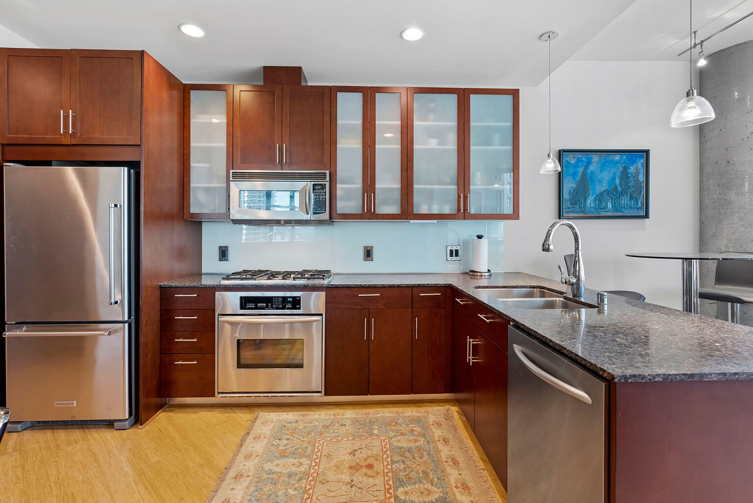 Newer KitchenAid stainless appliances including a gas range