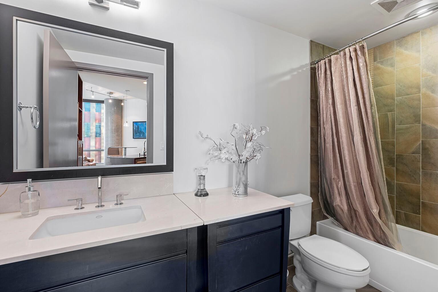 Bathroom with quartz-topped vanity