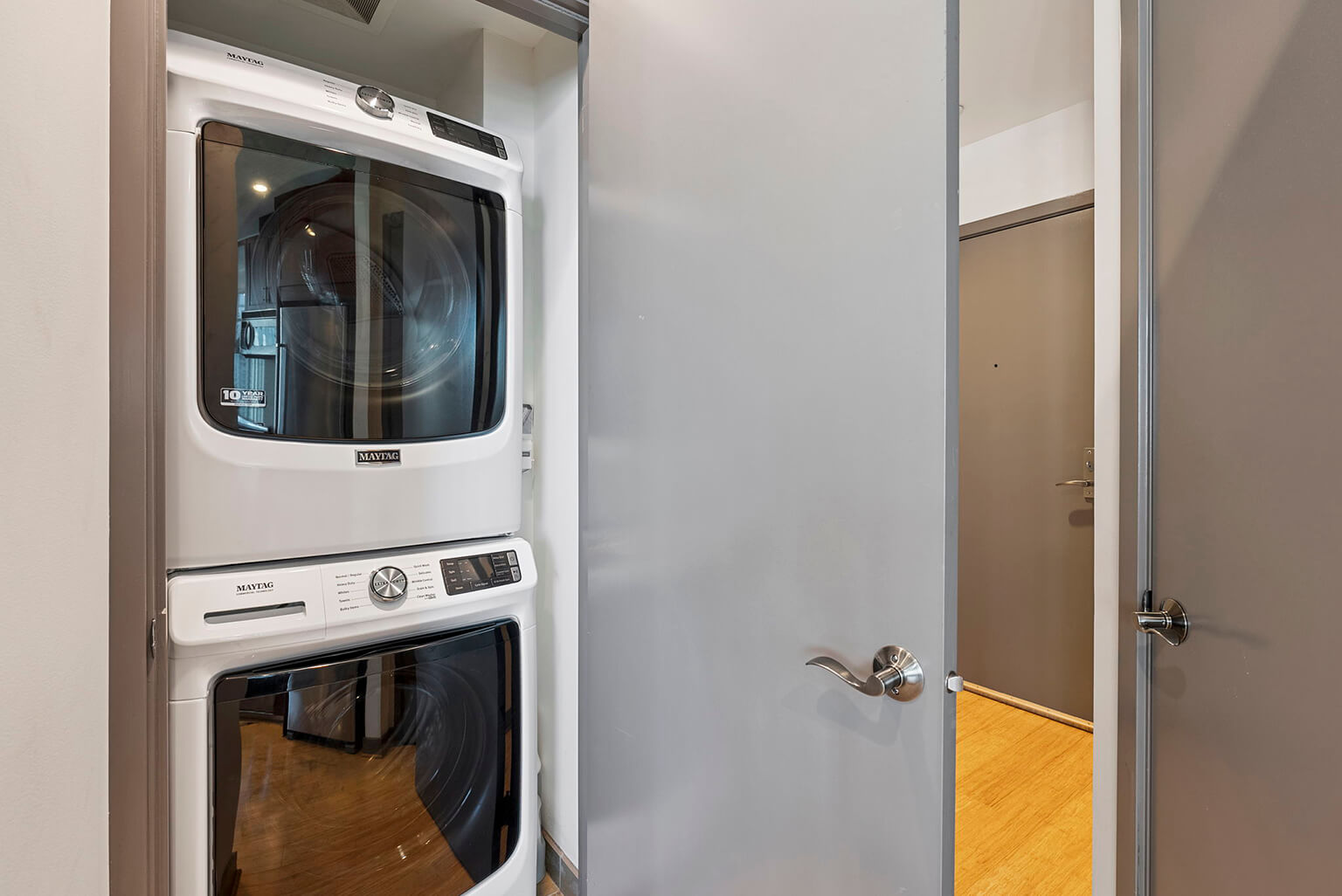 Full sized stacking washer and dryer off the kitchen