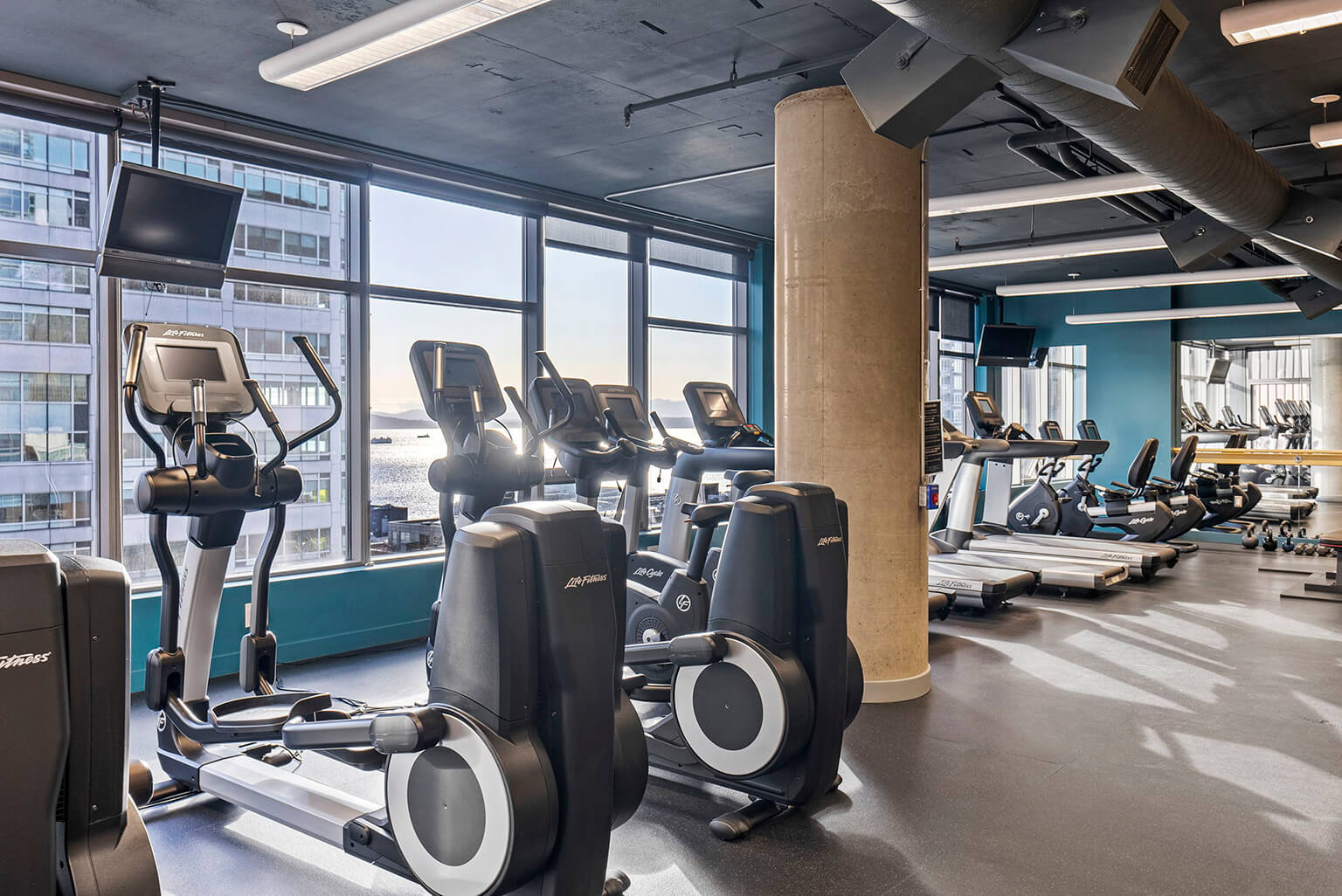 Sixth floor fitness room with cardio equipment and weights