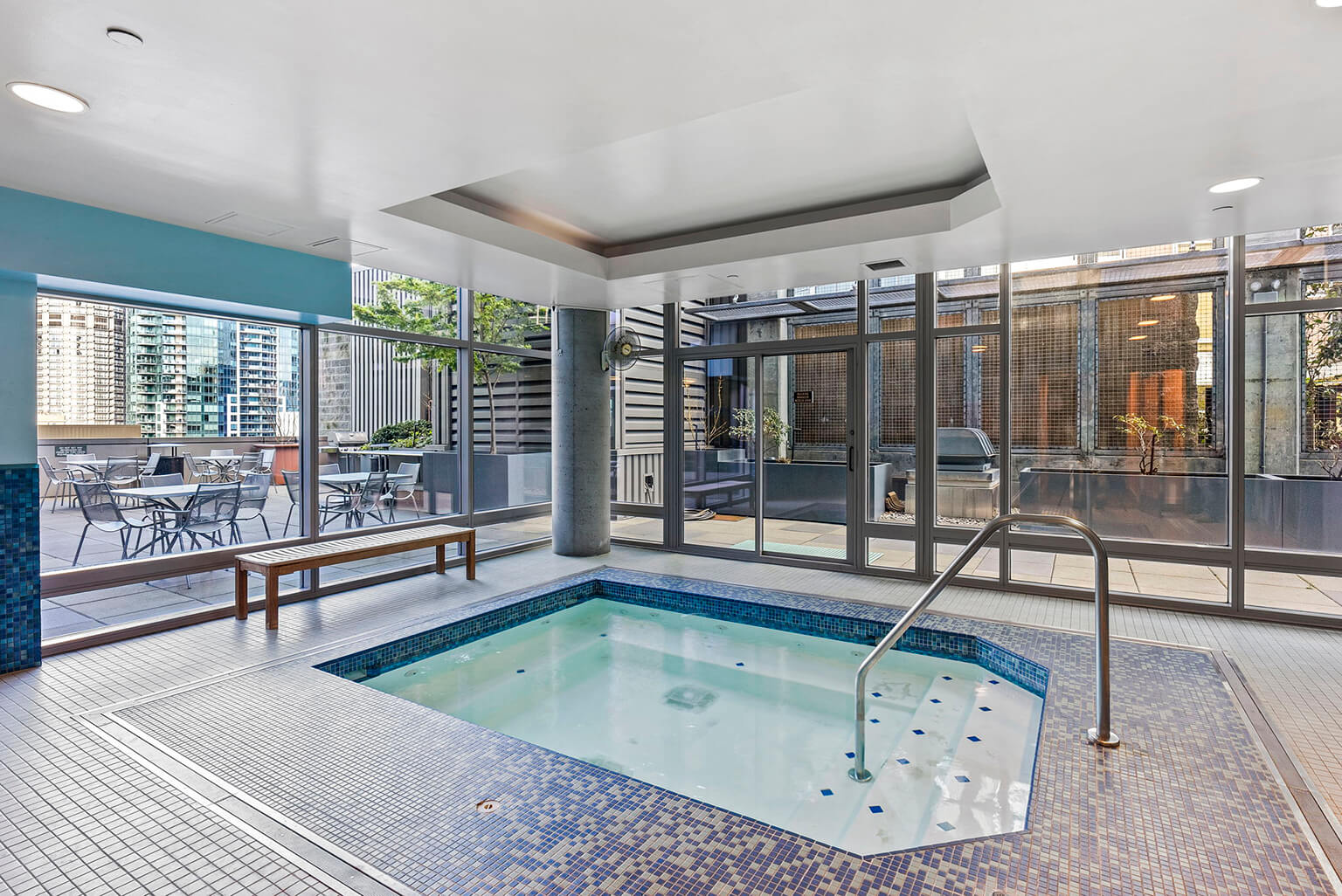 Spa and steam room are adjacent to the fitness room