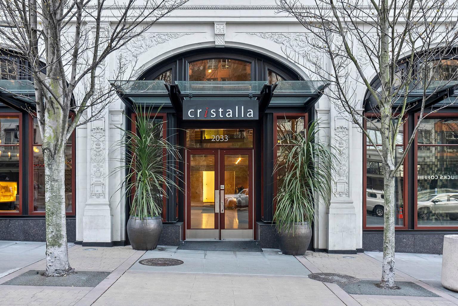 The current entrance retains the original building's neo-classical façade