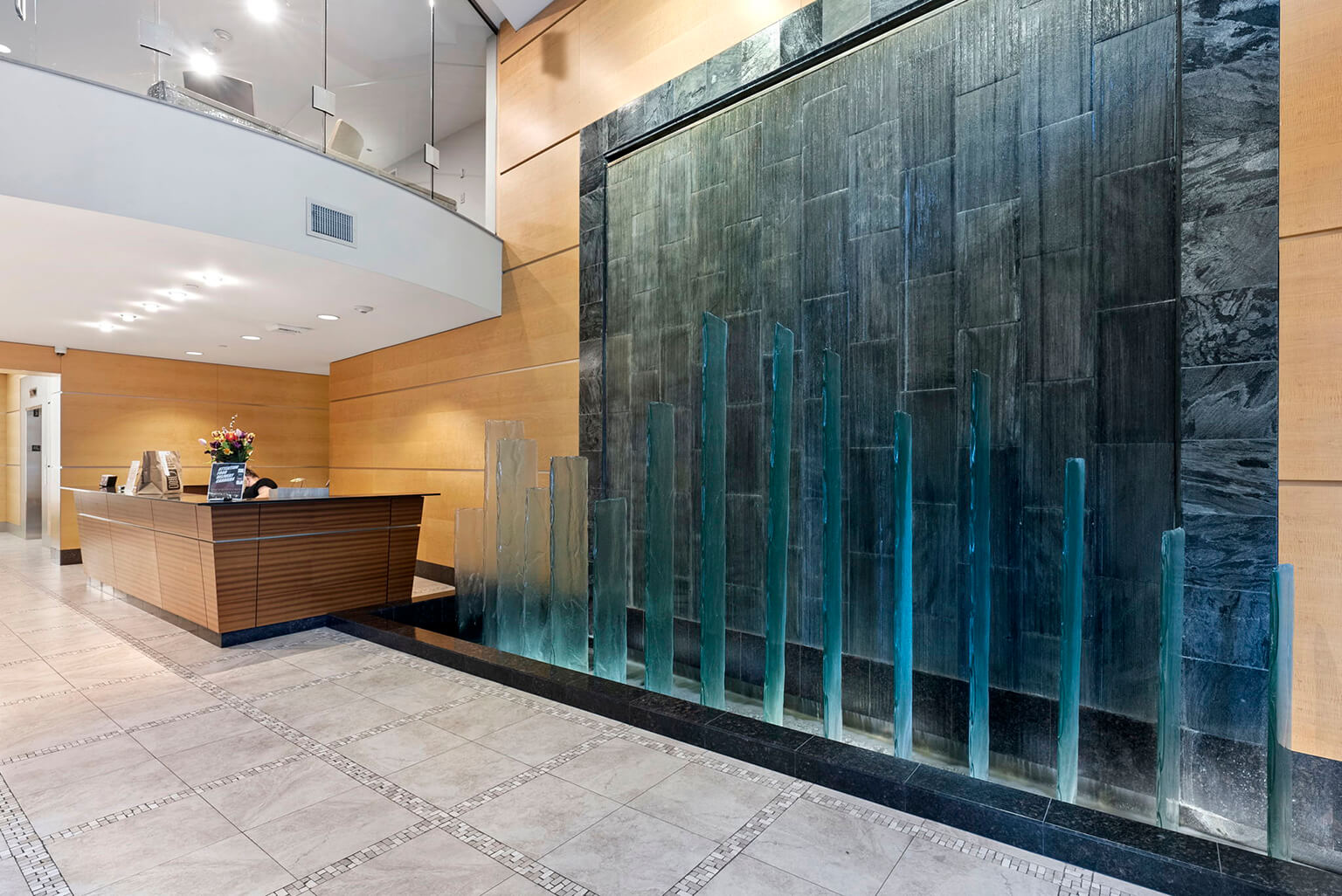 Impressive lobby with concierge desk and waterfall feature