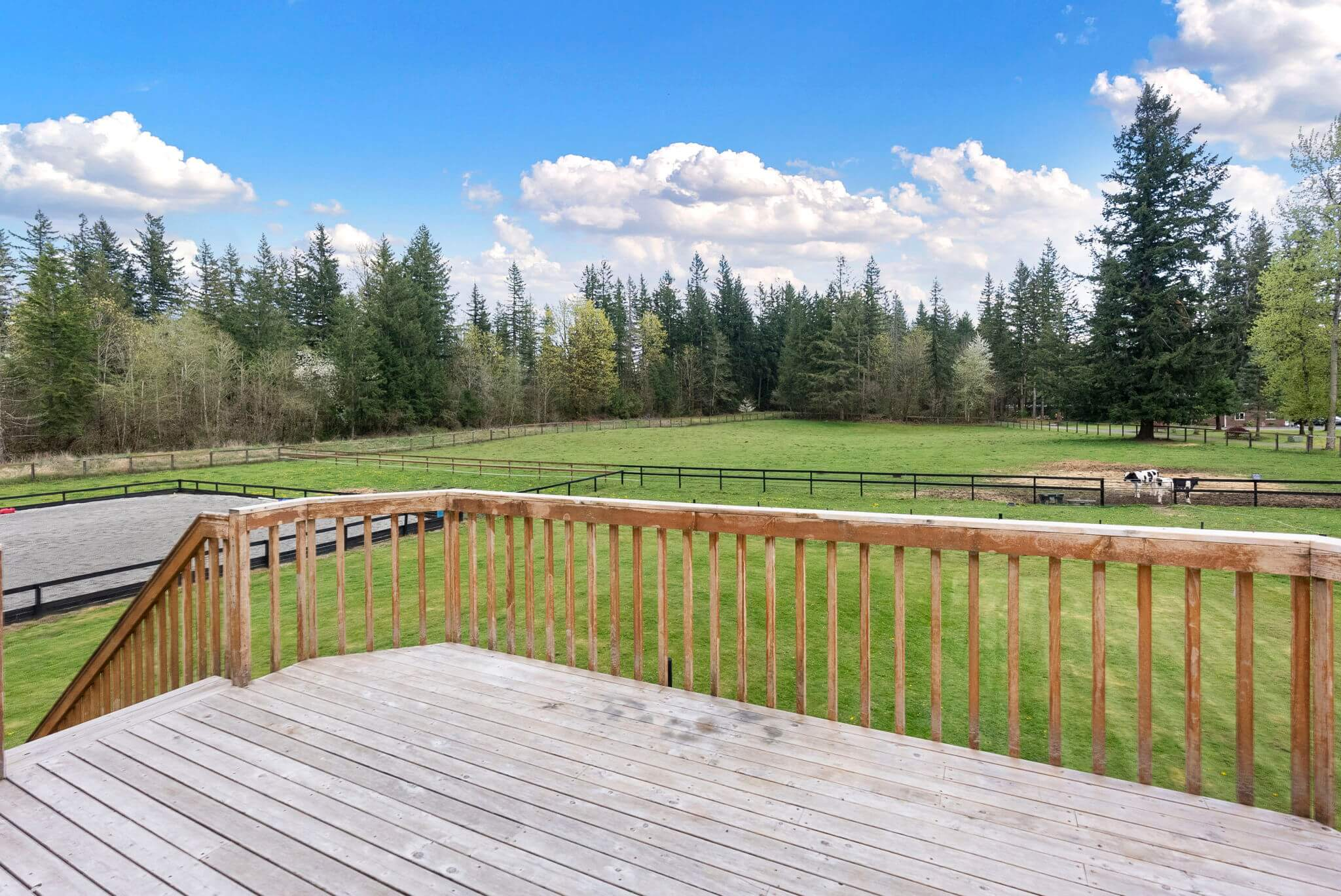 Guest apartment entry deck offers great pasture views