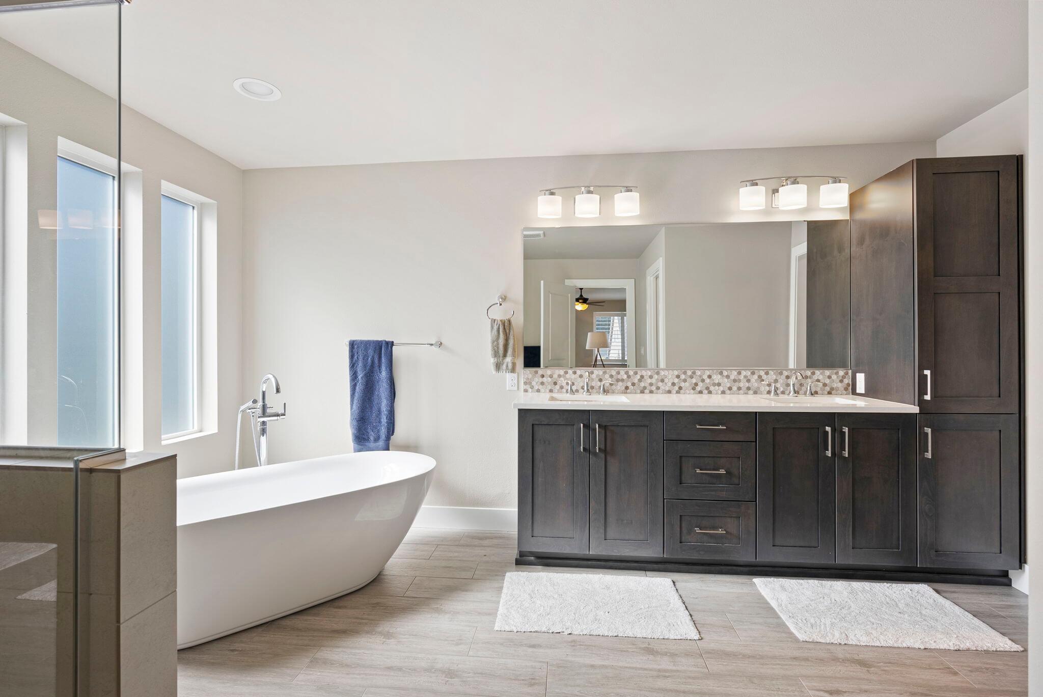 Luxurious primary bathroom with dual sink vanity