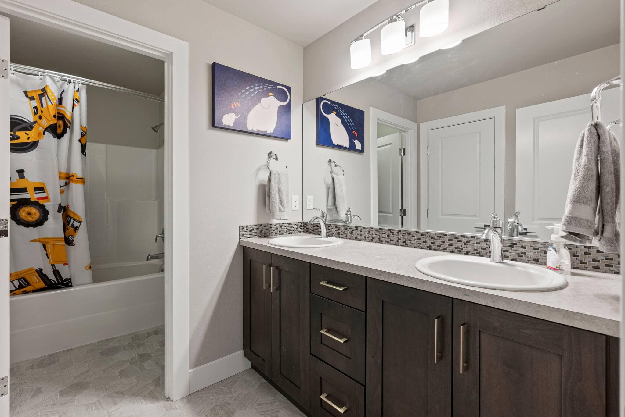 Upstairs full bathroom with dual sink vanity