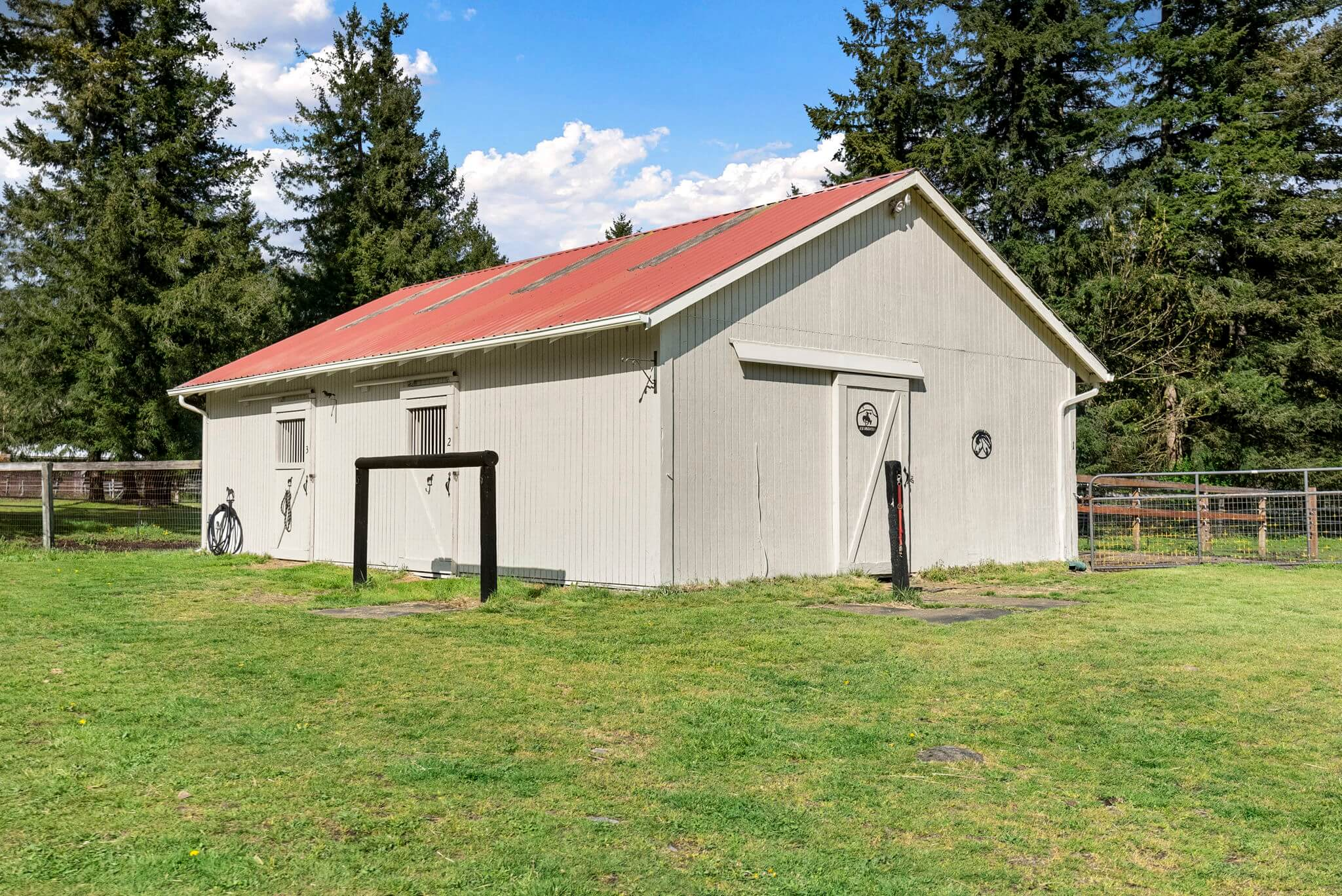 One of three smaller barns with a feed/tack room and three stalls with separate paddocks
