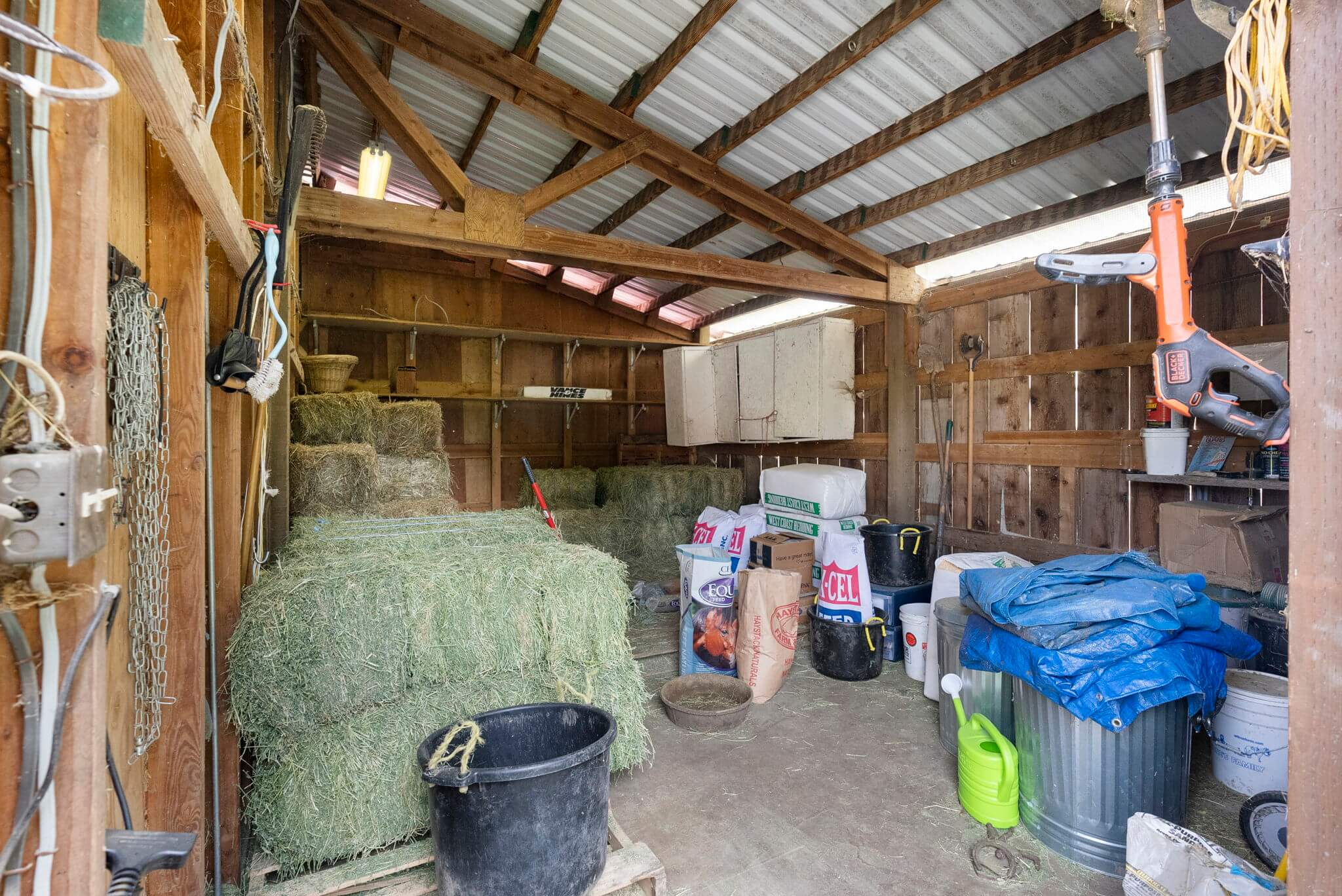 Each smaller barn has its own feed and tack room