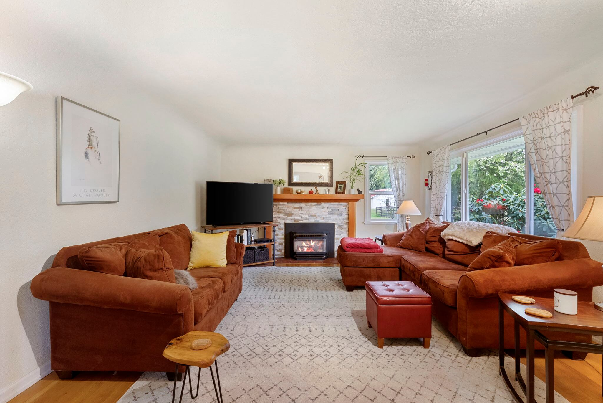 Living room with hardwood floors, coved ceiling and gas fireplace