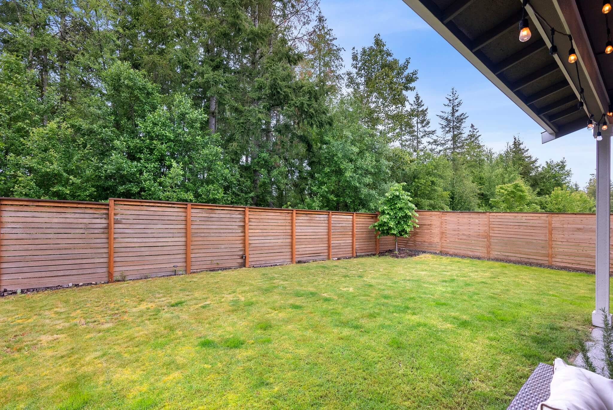Fully fenced yard backs up to greenbelt for added privacy