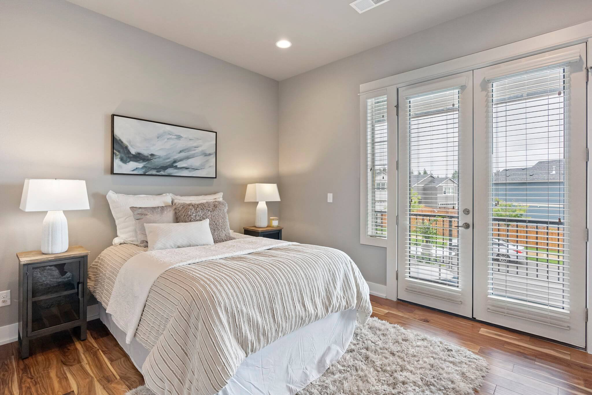 Main floor bedroom with French doors to a private balcony