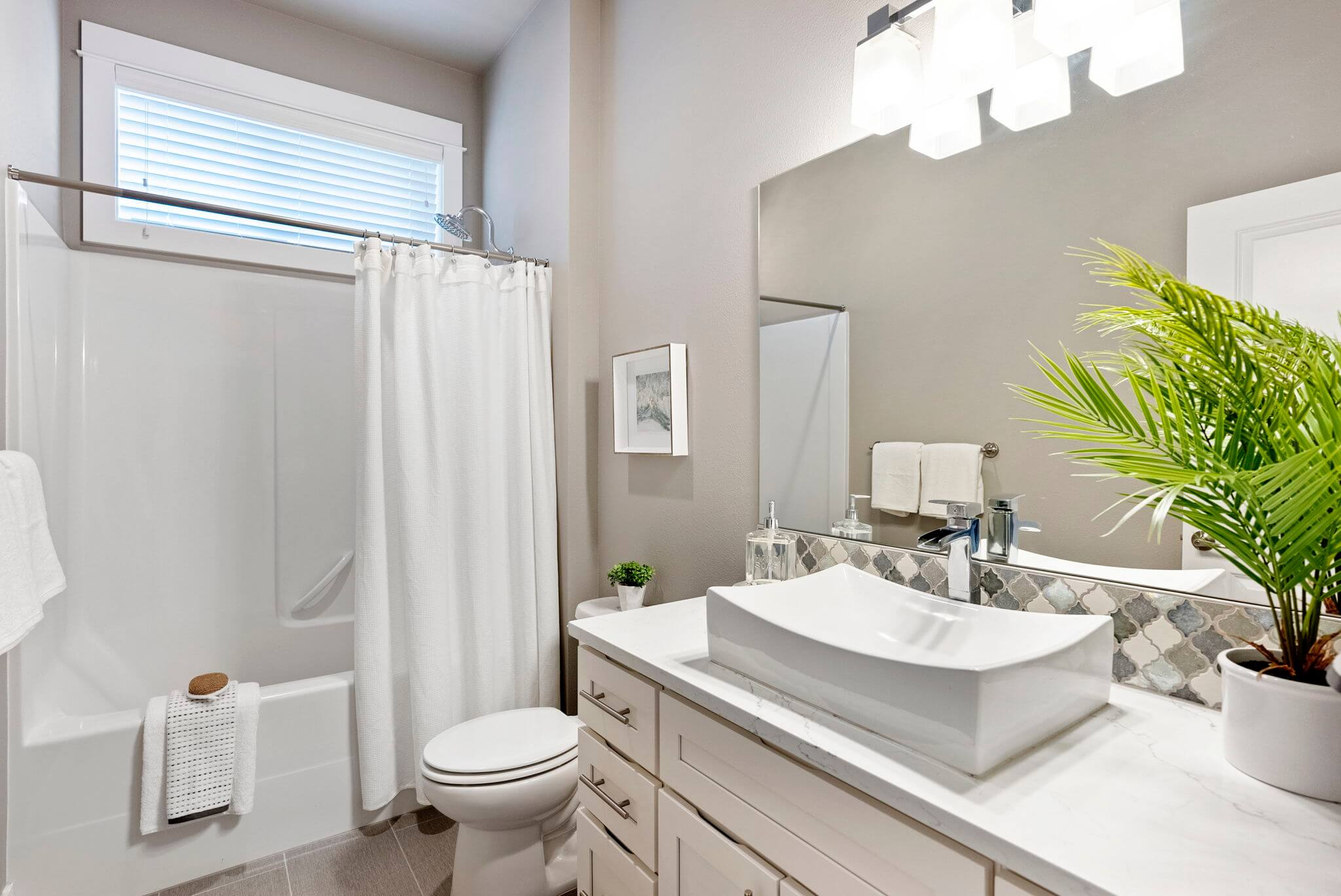 Main floor bathroom with vessel sink and tub/shower