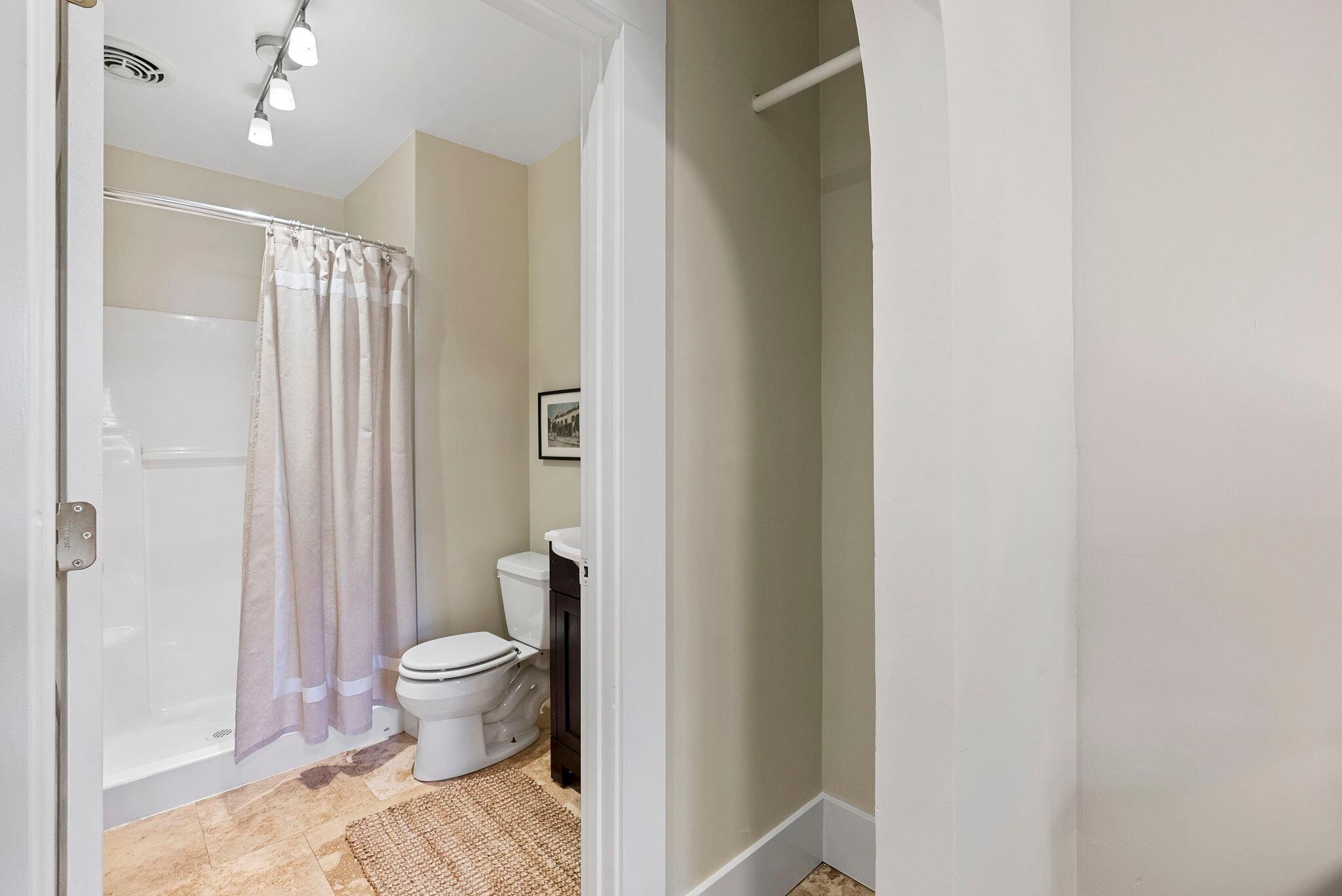 Master closet area and en suite bathroom