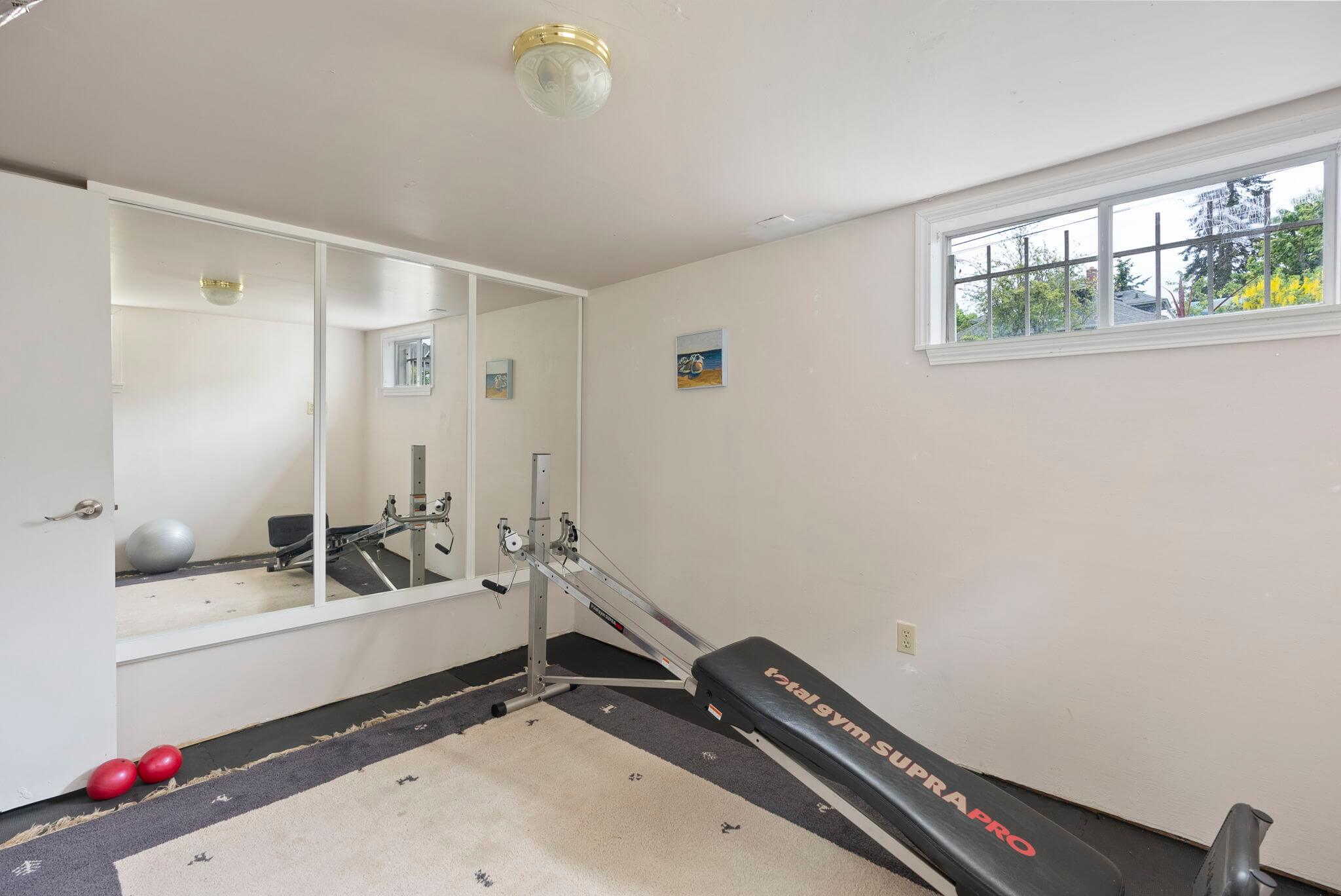 Den/office on the lower level is currently used as a fitness room