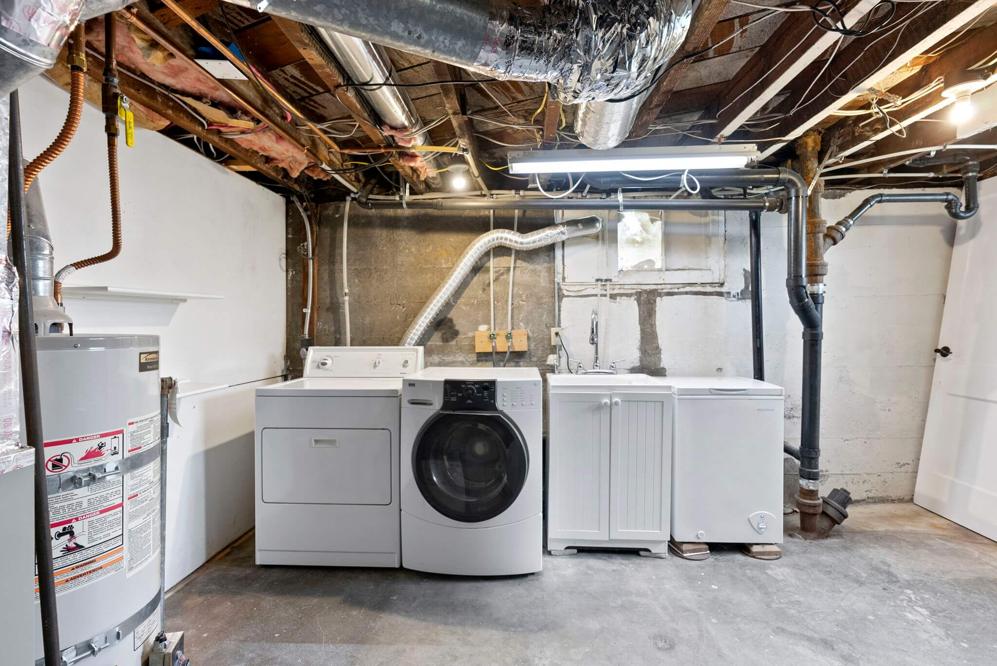 Laundry area with sink and freezer