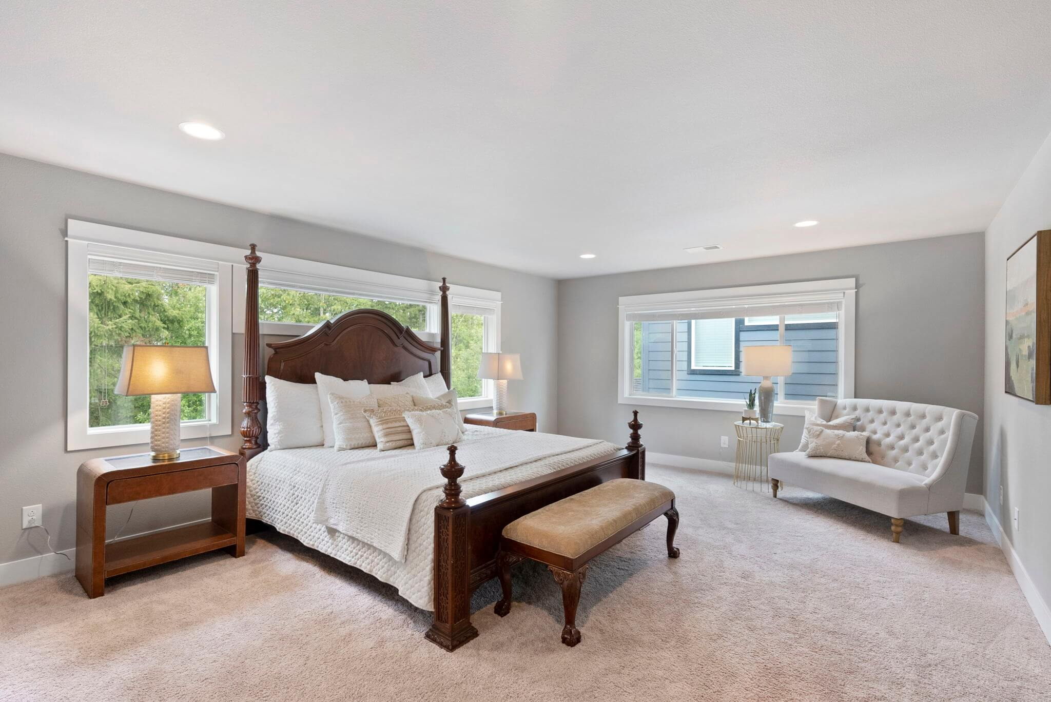Spacious primary bedroom with sitting area