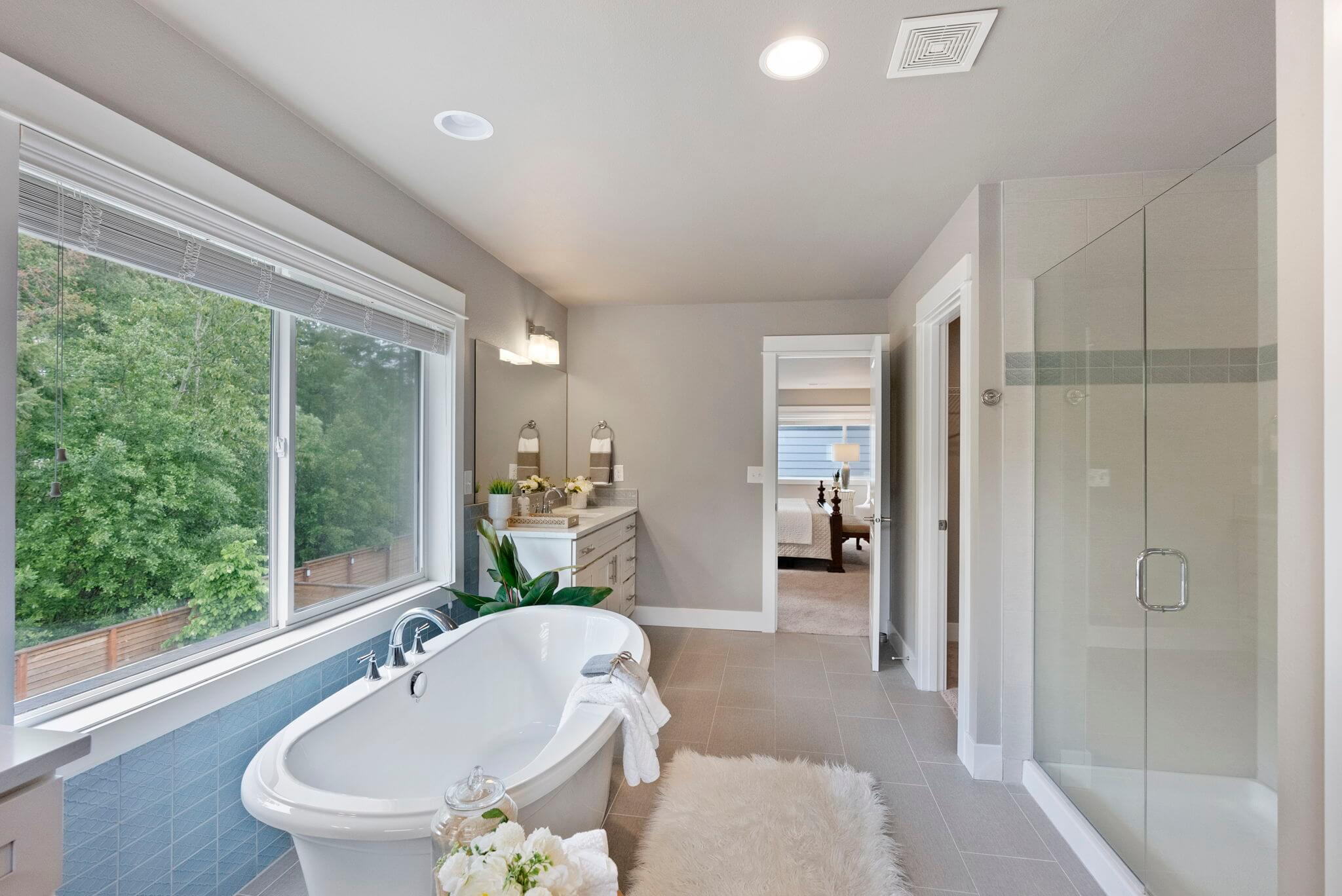 En suite primary bathroom with separate tub and shower