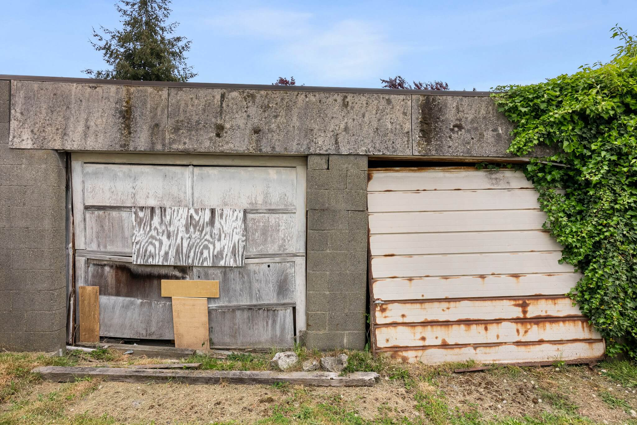 Two car garage that could be replaced with a new garage and/or DADU
