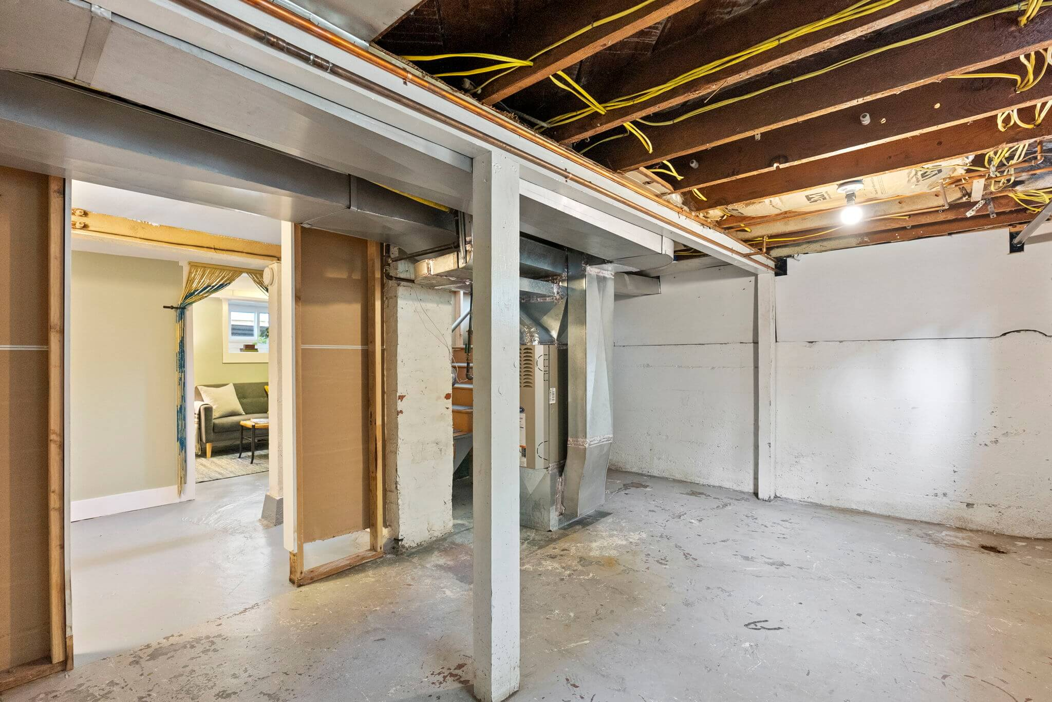 Unfinished portion of the basement offers plenty of storage space