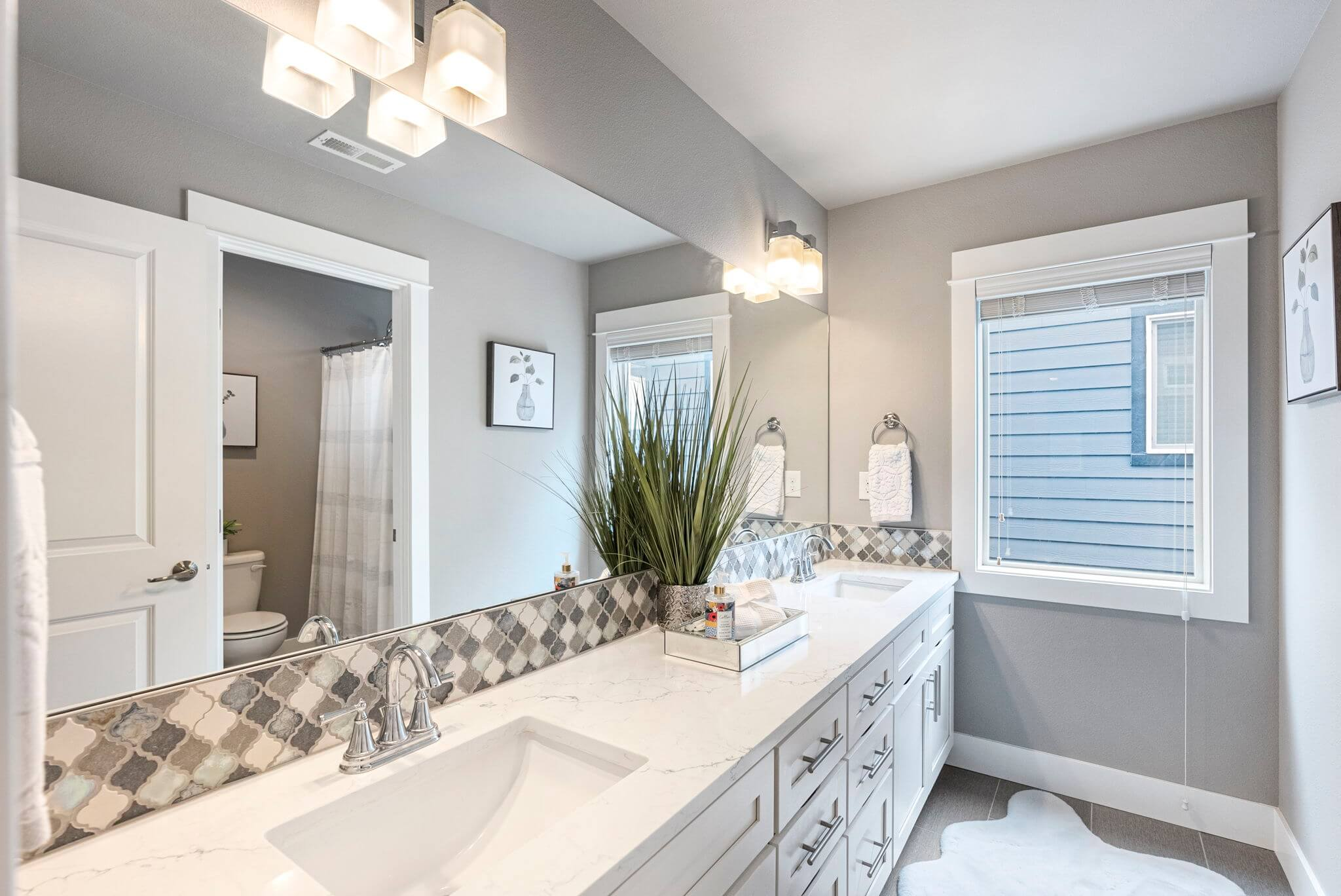 Upstairs hall bath with dual sink quartz topped vanity
