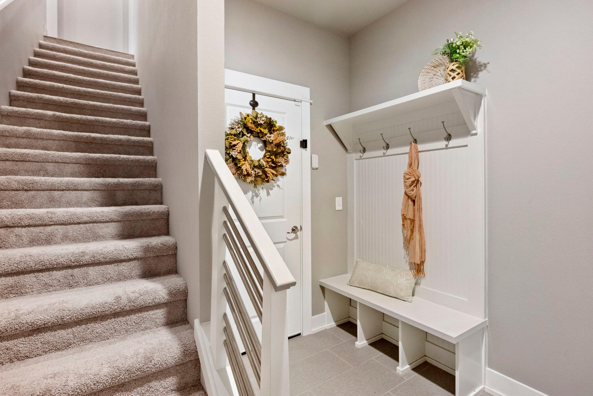 Entry stairs from attached three car garage