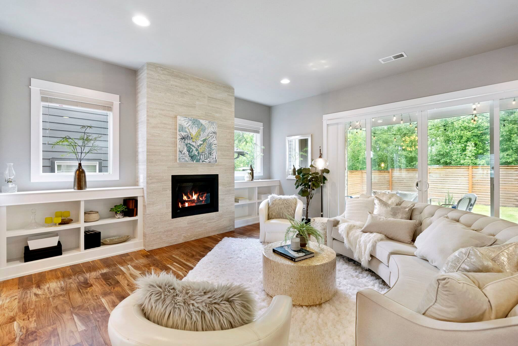 Built-in bookshelves and stone fireplace surround