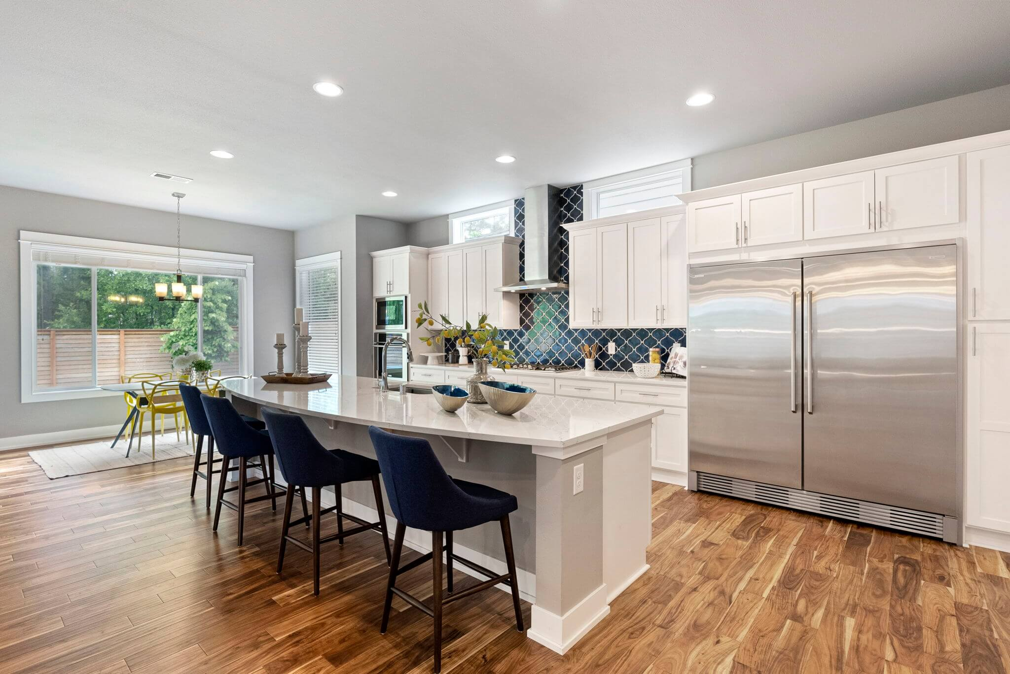 """Gourmet eat-in kitchen with 60"""" stainless refrigerator and walk-in pantry"""