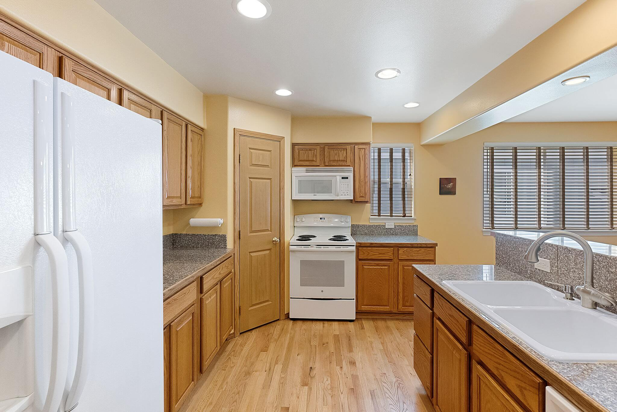 Kitchen features granite counters and a pantry