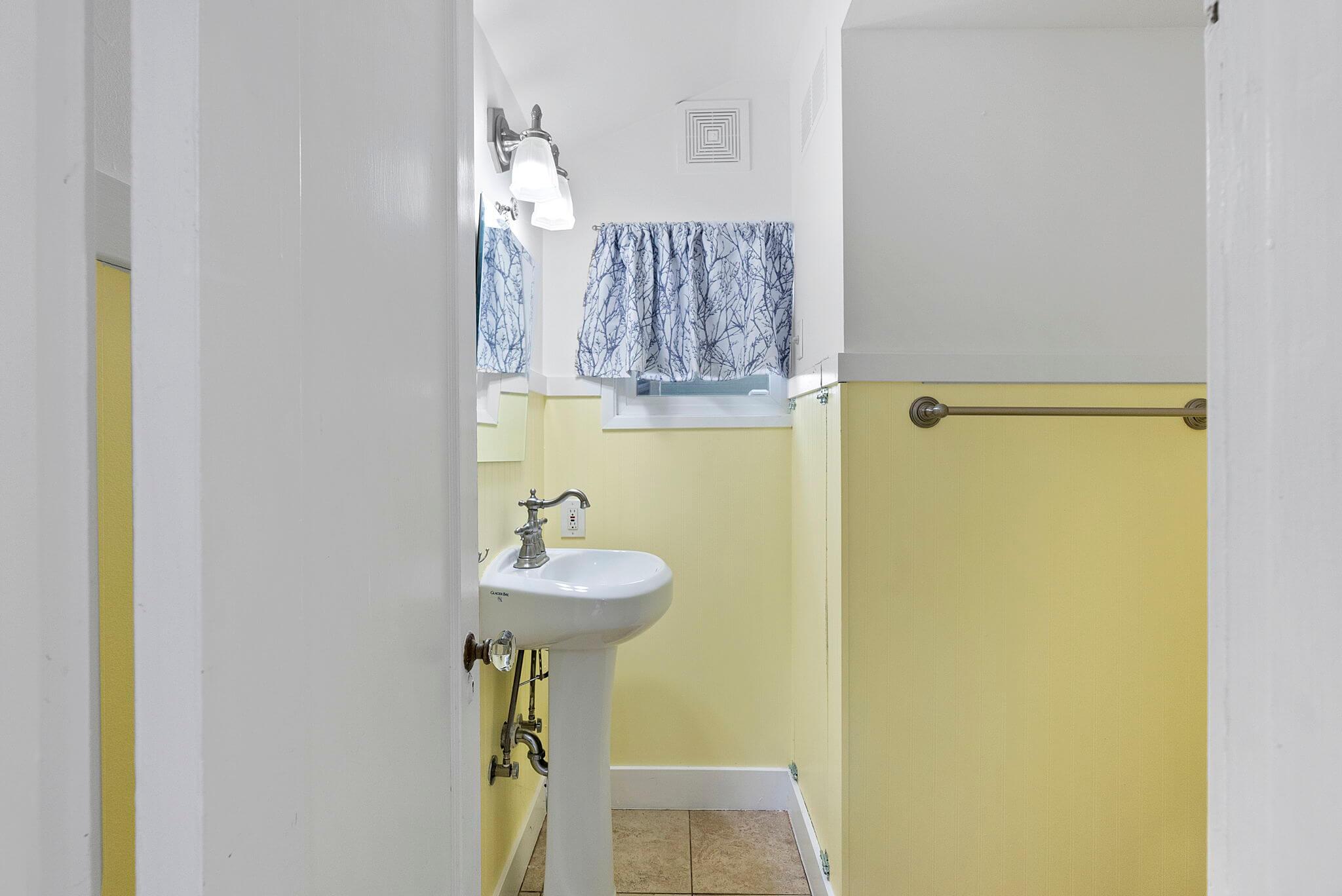 Half bathroom off the kitchen