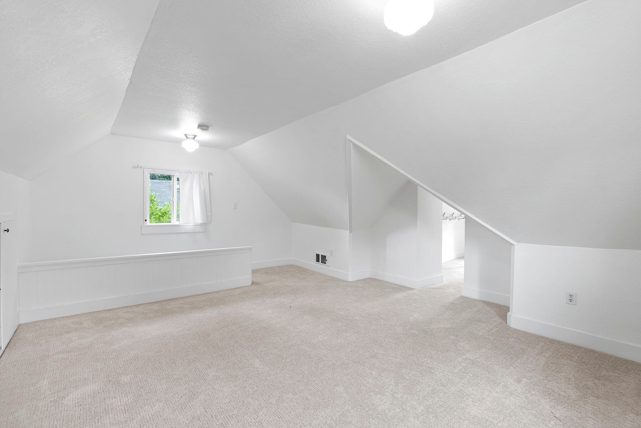 Bedroom number four on the third floor could easily be used as a family room instead