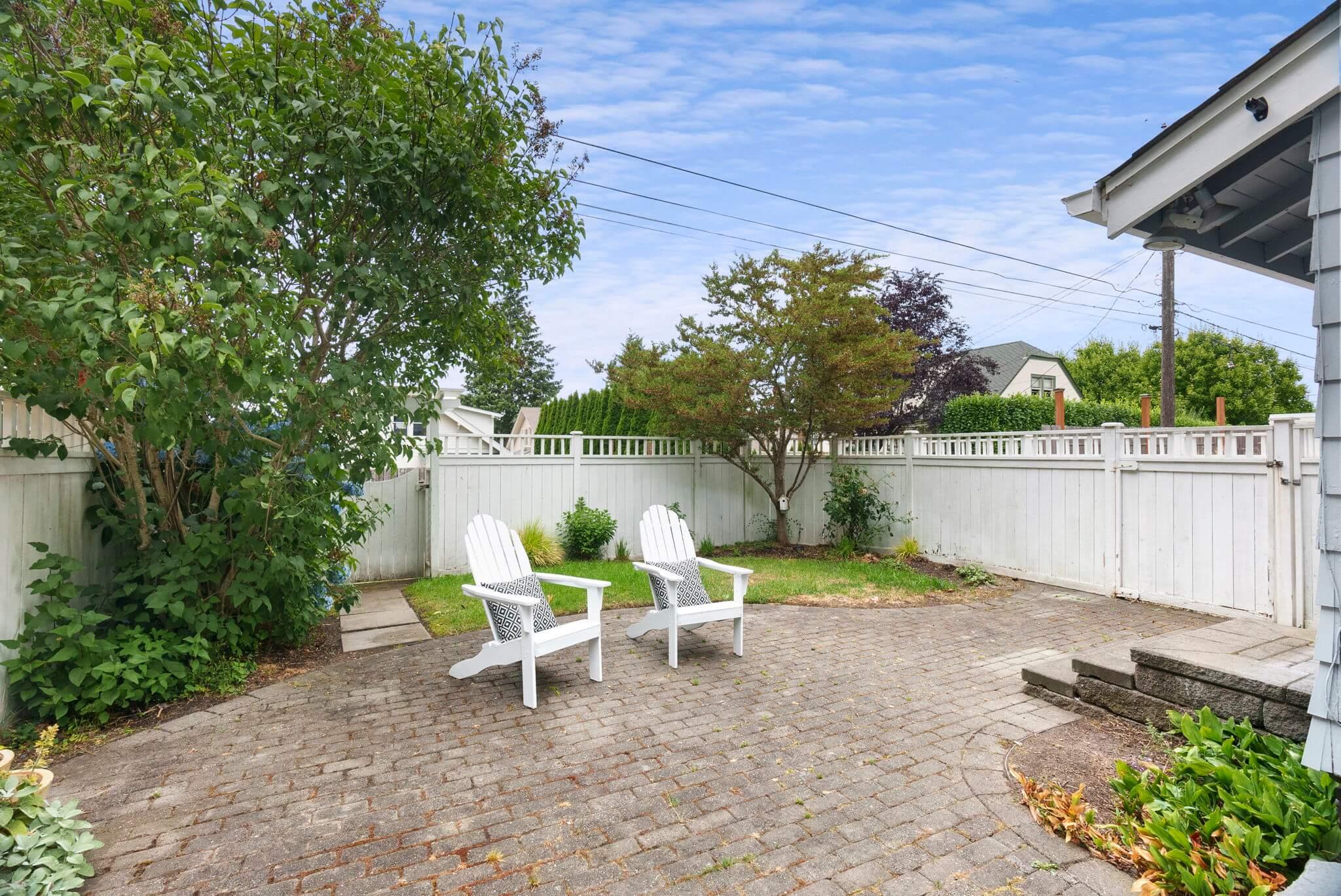 Fenced yard with sprinkler system