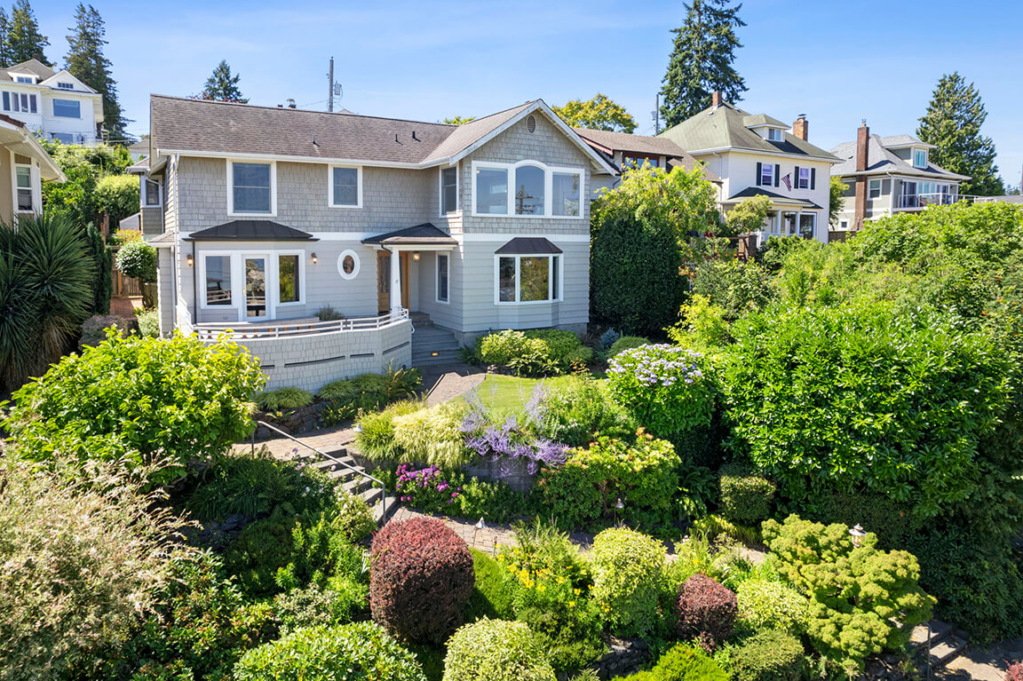 Stately 1939 Shingle Style Traditional nicely sited above the street