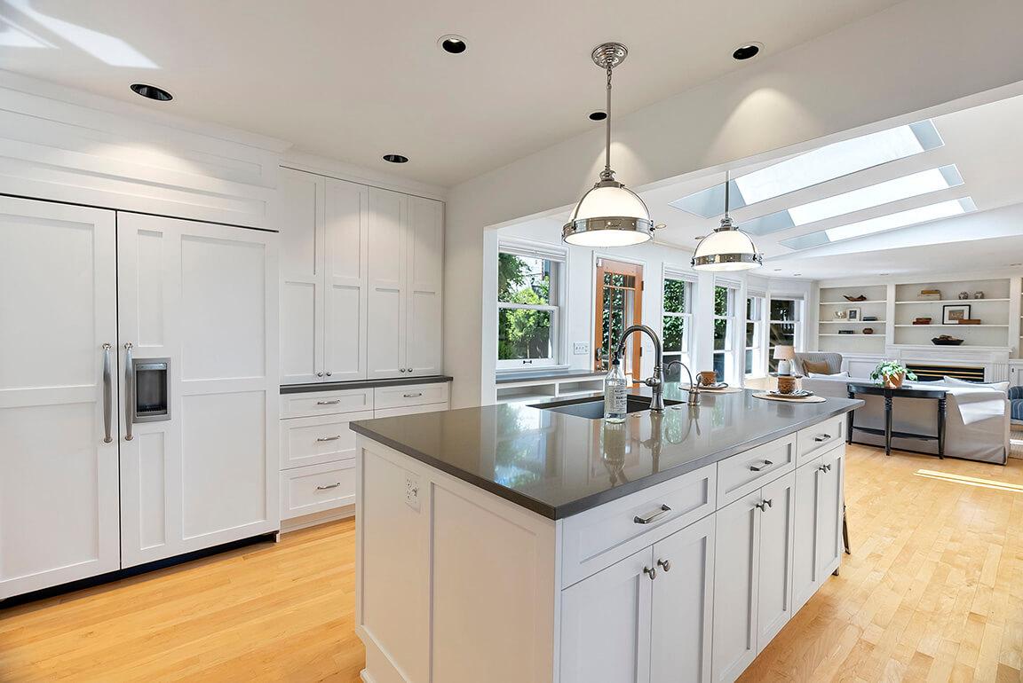 Quartz counters, paneled Sub-Zero refrigerator and bakery pantry