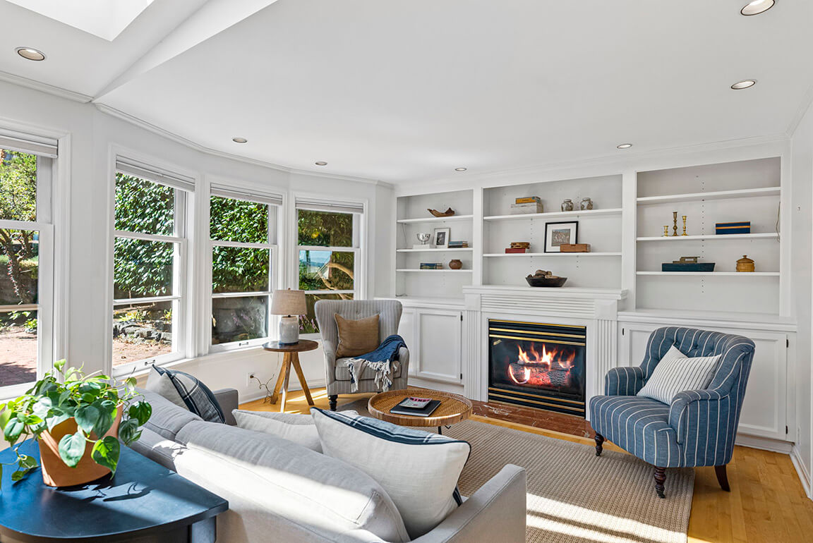 Family room with gas burning fireplace and built-in storage