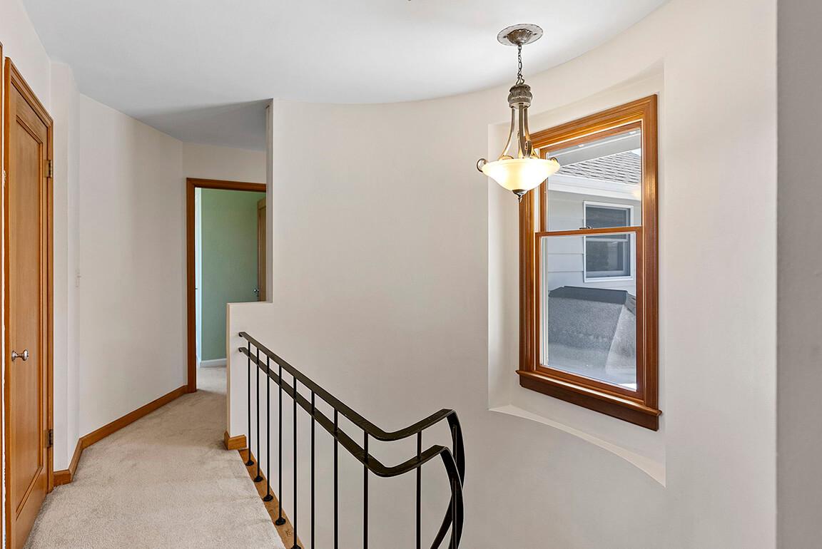 Upstairs landing with original mahogany doors and trim