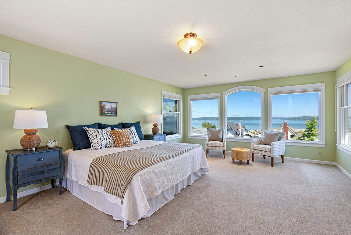 Large primary bedroom with stunning water views