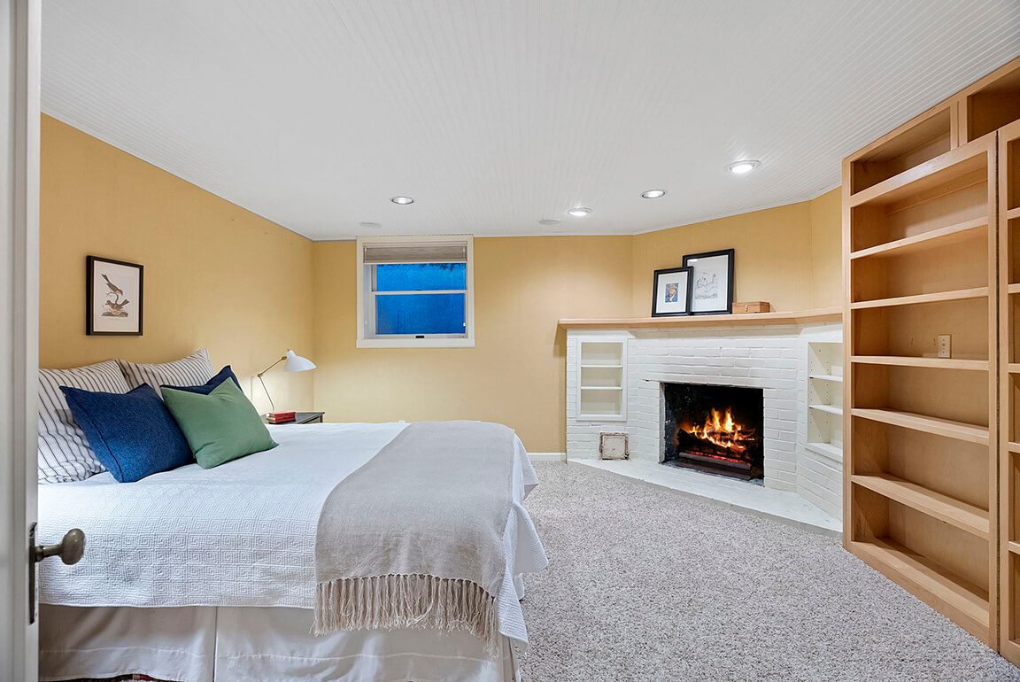 Fourth bedroom with fireplace on the lower level could be used as a den