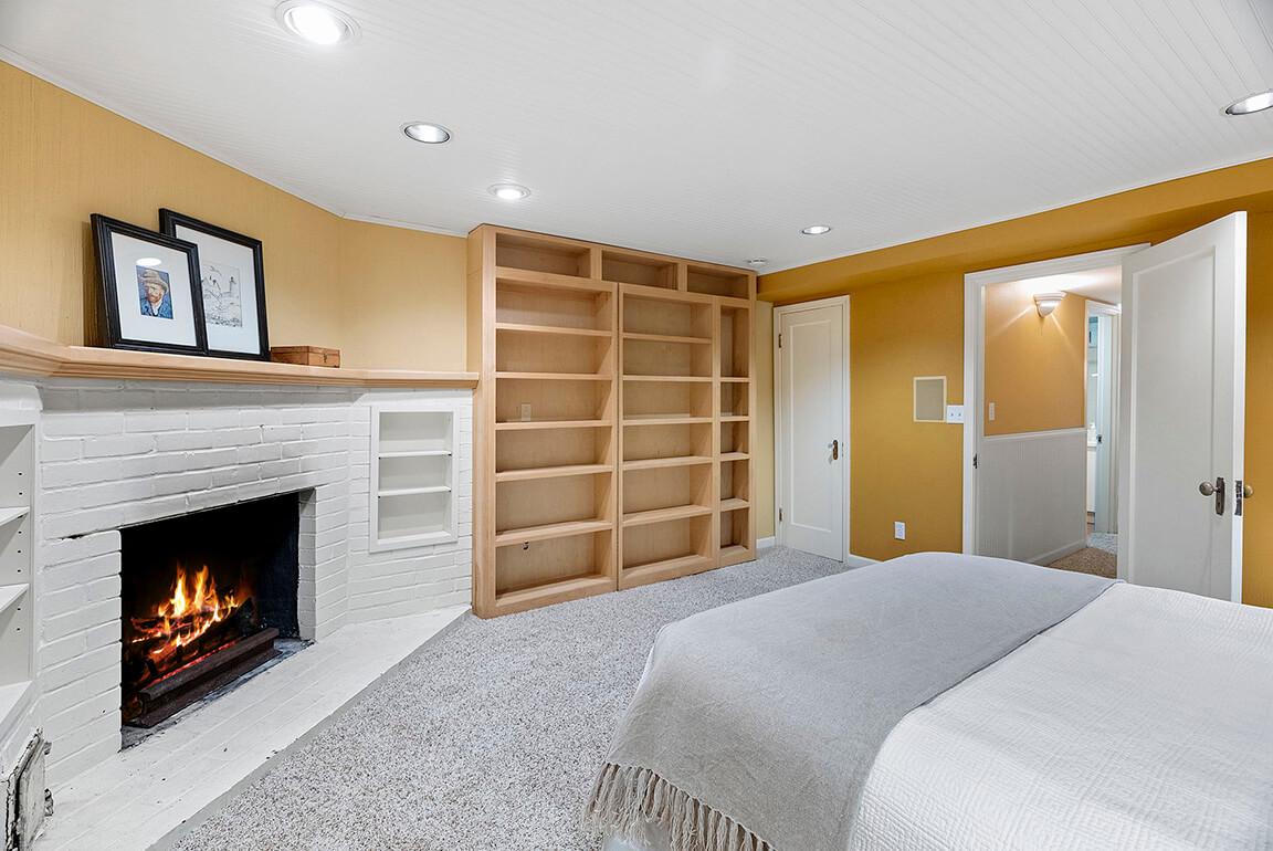 Secret wine cellar is located behind the bedroom bookshelves