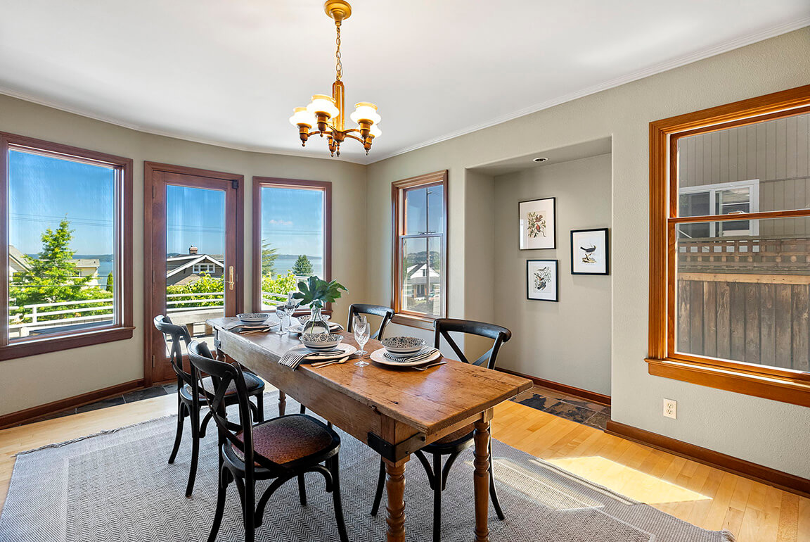 Formal dining room with mahogany trim and direct access to a view deck