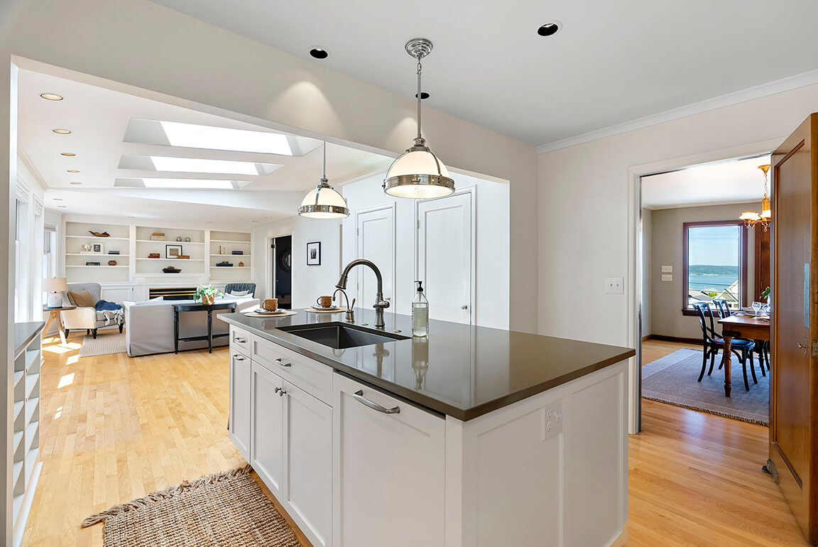 Thoughtfully updated kitchen off the dining room is open to the family room