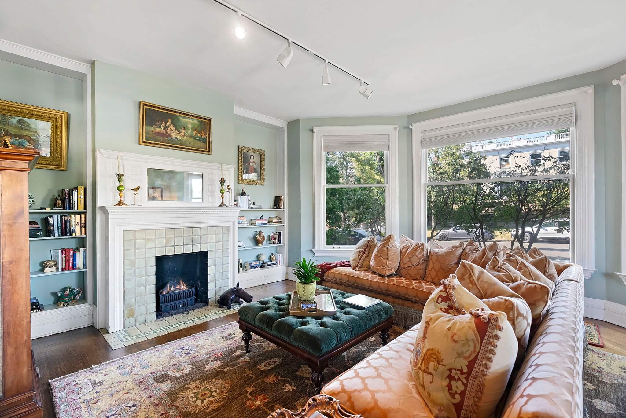 Formal living room with gas fireplace, vintage coal basket and original tile surround